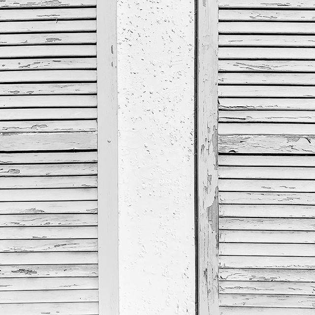 These shutters are almost perfect for the building. They are the height of the window openings and exactly half the width. Unfortunately, they've been screwed directly into the wall, which completely destroys their appearance. #windows #perfect #wall #house #home #office #work #project #manager