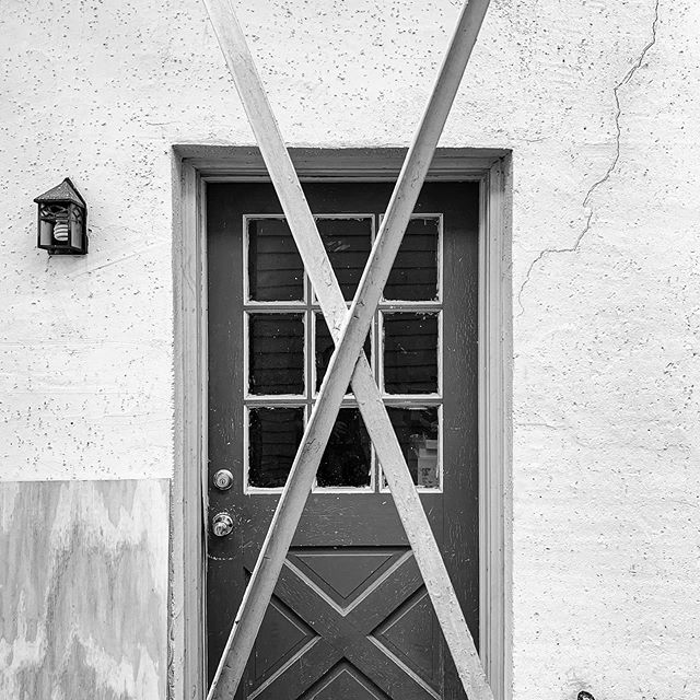 """Behind the """"X"""" stands a colonial, revival door from the 1970s that's not entirely appropriate for the building. Since we were unable to find out what the original door might have looked like, we kept this one as part of the building's layered history. #original #office #work #building #history #south #project #projectmanagement"""
