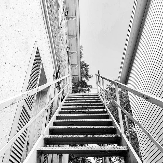Metal fire escapes were once added to many buildings around Savannah as a requirement for any HUD project receiving federal funds. Today, building code recognizes a window as a form of egress, making this staircase redundant. #history #today #escape #stairs #window #building #code #project