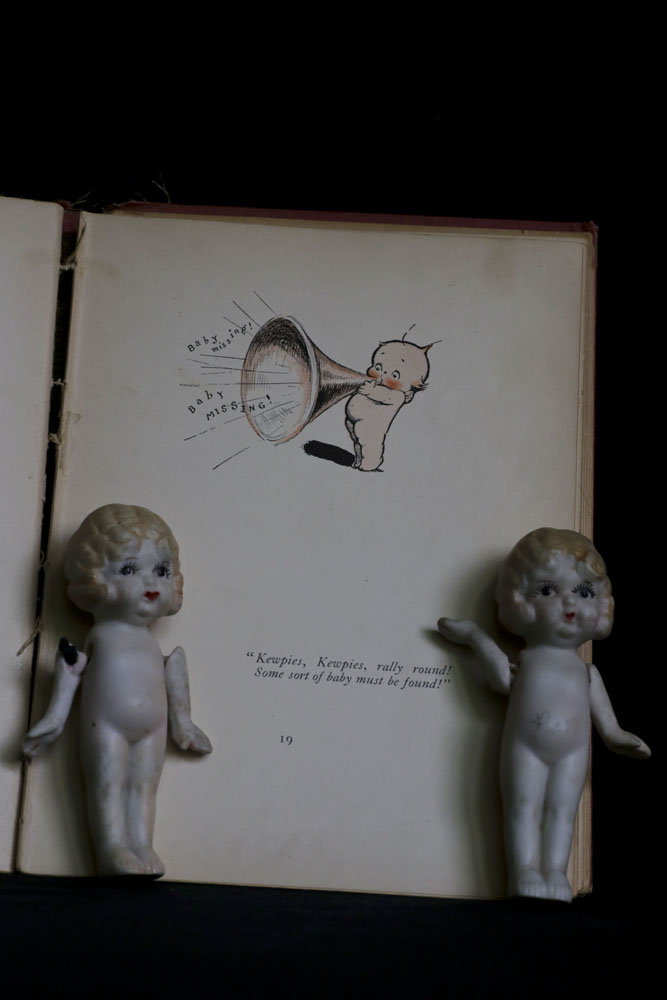 They delighted in paging through the book Kewpies and the Runaway Baby, and were amazed that the kewpies were almost as cute as they are.