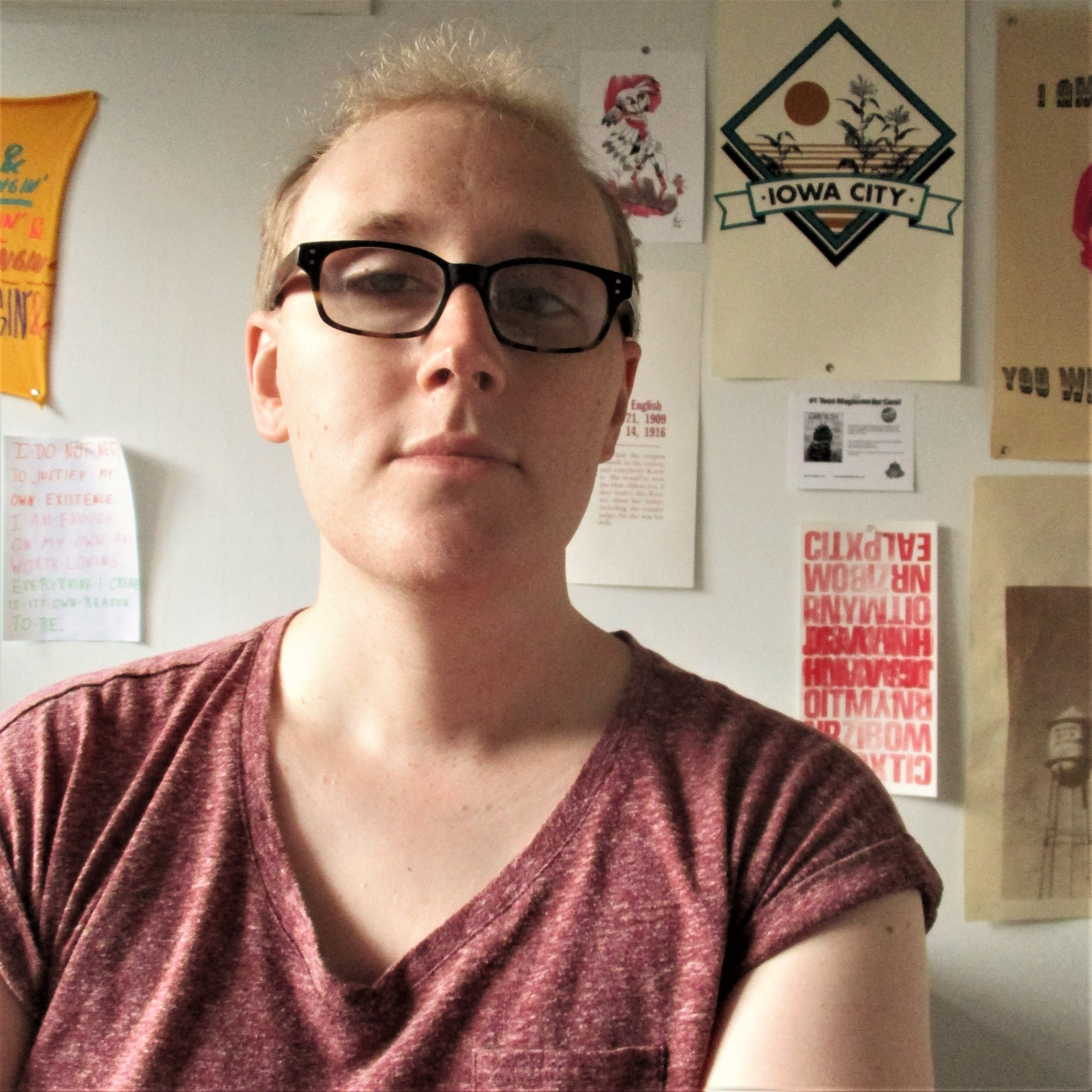 Violet Louisa Austerlitz  (she/her/hers) draws comics about personal identity and the soil in which it grows, using digital and traditional media. She frequently explores her own experience as a queer and trans person, both literally and through the medium of sentient dandelions.  She is ambivalent about her formal education (BA Theatre, Truman State University, 2011), but still loves learning new things, and recently completed Melanie Gillman's Graphic Memoir workshop at the Center for Cartoon Studies in Vermont (which was like BONKERS good, they're a wonderful teacher).  She is based in Iowa City, IA, and self-publishes her own comics and zines. She is also a long-standing member of the Iowa City Press Co-Op, a community printmaking studio.  Here are some very good webcomics by queer and trans folks that you would do well to investigate:   As The Crow Flies  , by Melanie Gillman   On a Sunbeam  , by Tillie Walden   Goodbye to Halos  , by Valerie Halla