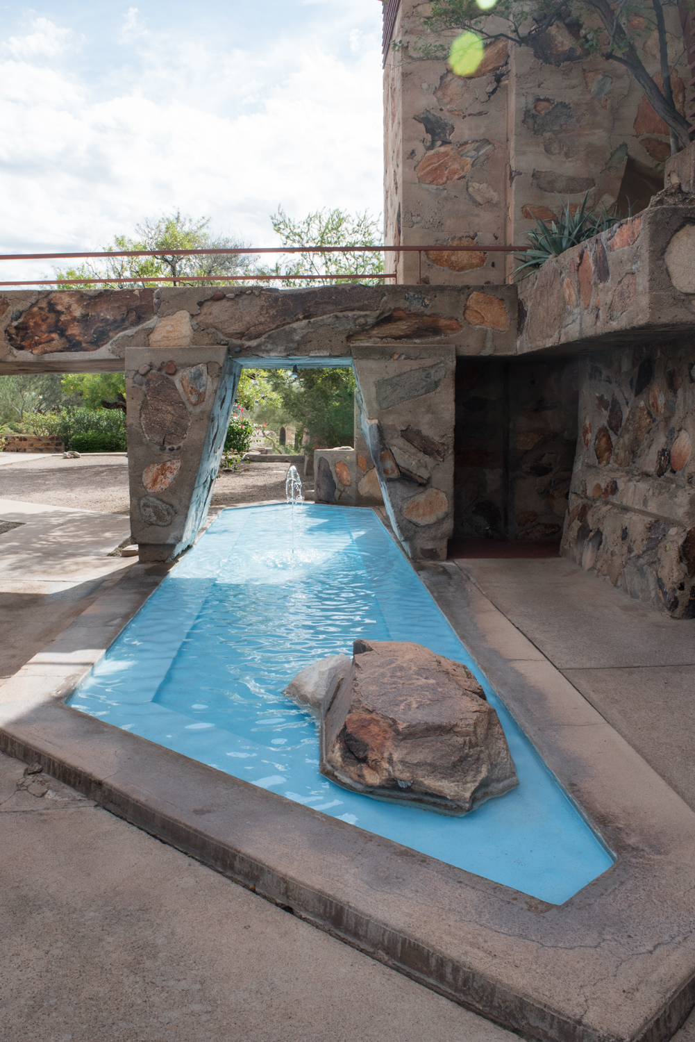 Look closely at the boulder in this water feature, and you'll see authentic petroglyphs, an inspiration to Wright's designs.