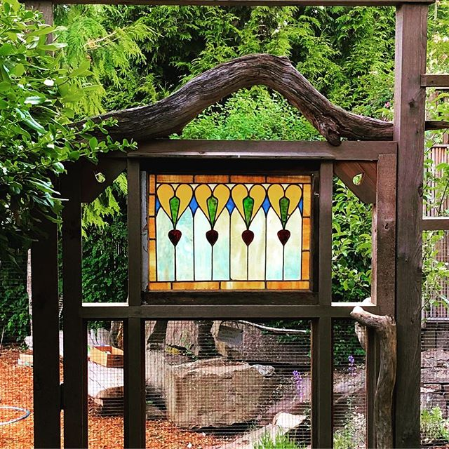 Stained glass should not be limited the house.. #architecturalsalvagesd #gardengate #stainesglass#jardin #salvage #gardening #reuse #rusticdecor #growsomethinggreen #organicgardening #architecturaralsalvage #farmhousestyle #stainedglasswindow #oldwindows