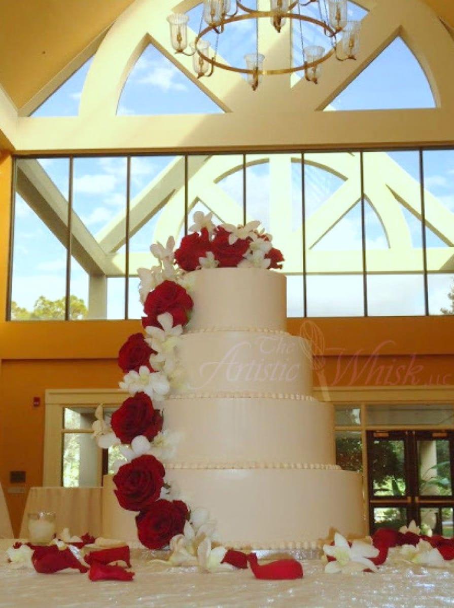 cascading-red-roses-on-buttercream---a-bride's-bouquet-florist---innisbrook-09-14-09-512-io.jpg