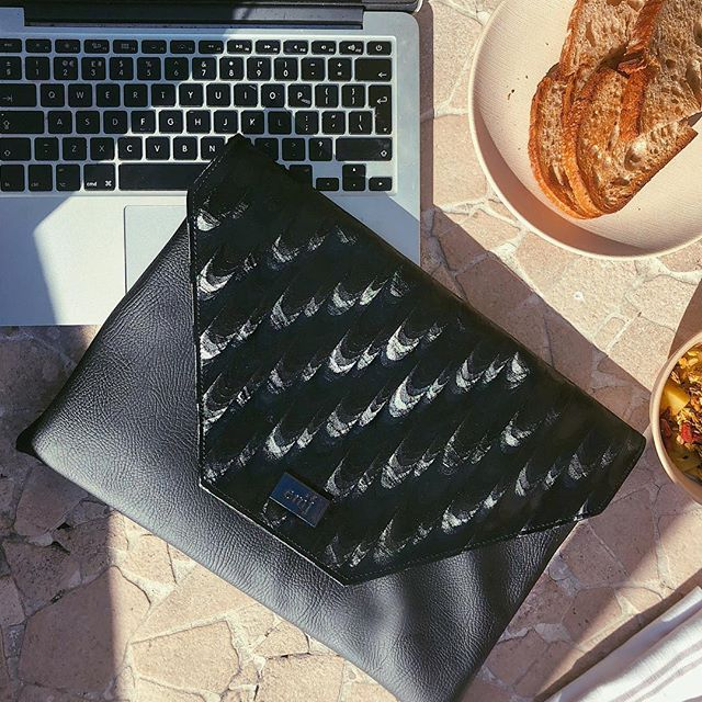 G.I.V.E.A.W.A.Y ✨ Sitting on a rooftop in Barcelona today beavering away on the laptop and can't stop looking at my new laptop clutch 😍😍😍 We havn't launched these yet but I want to give one away to you guys as a thank you for following me, your love and support! 🤓They come in all of our collections at @emjcompany tell me which print you'd like yours in and tag two buddies who you think would like one too! 💪🏽👑👩🏽💻🕶 #laptop #laptopbag #tech #techaccessories #dressyourtech #flatlay #techwear #fashion #britishdesigner #veganfashion #girlboss #femaleboss #giveaway #competition #veganfashion