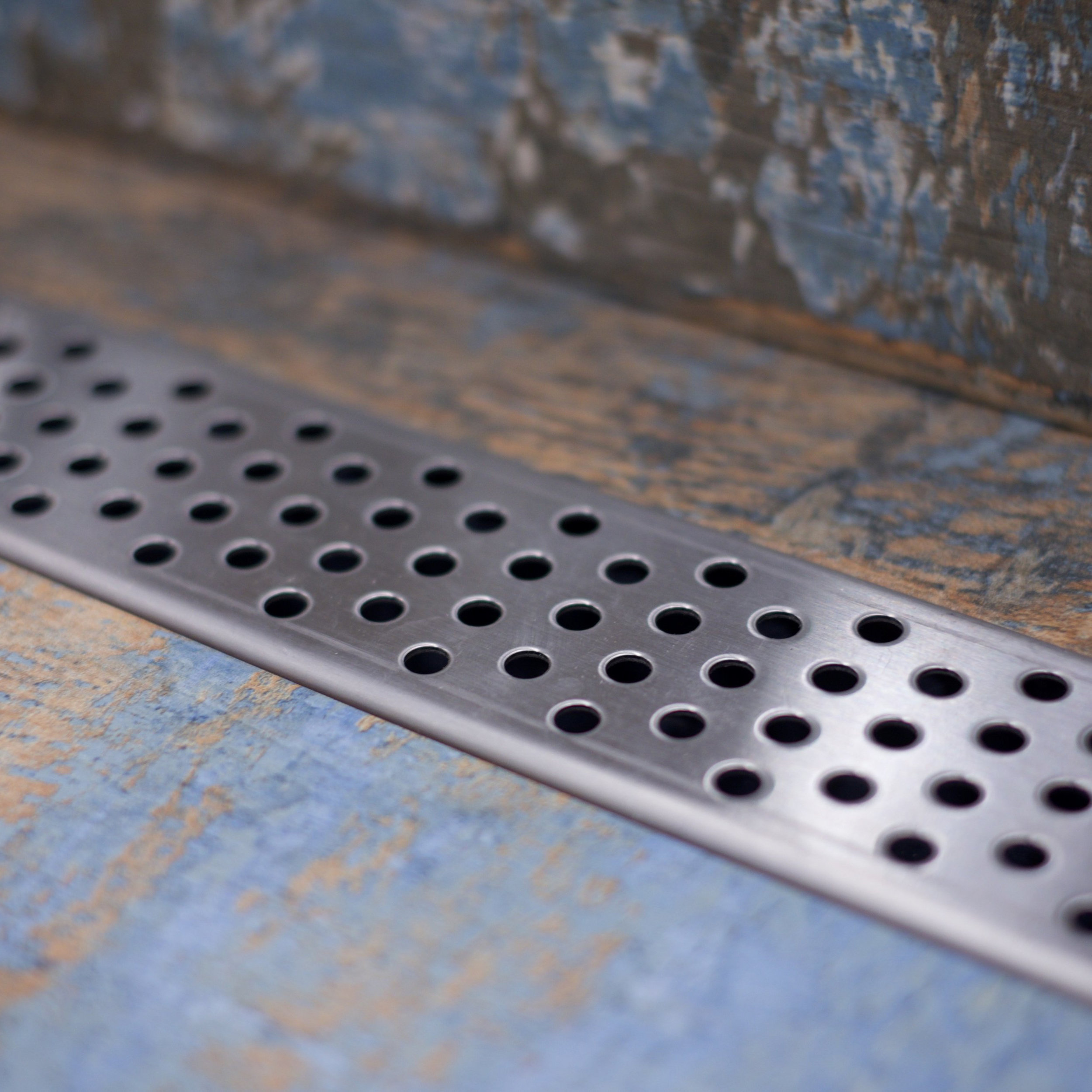 Linear shower drain grate