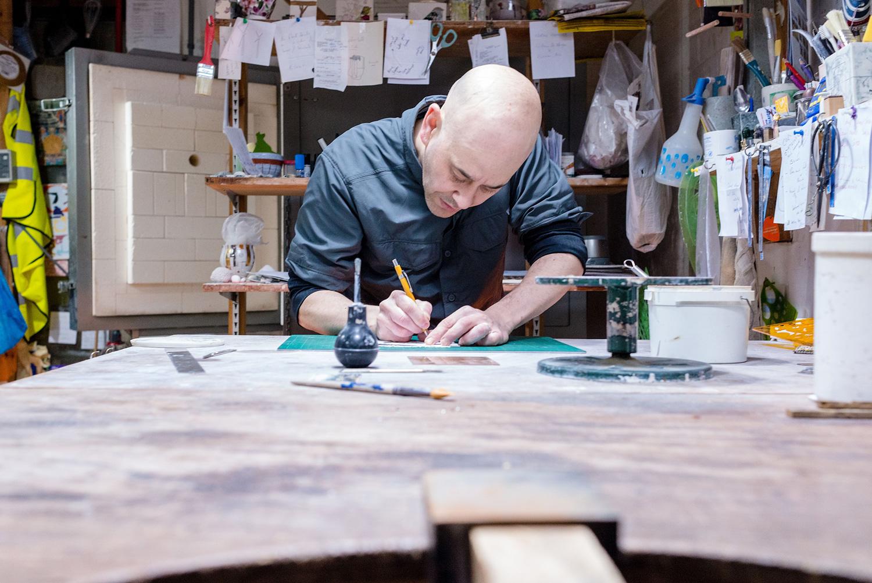 lee-page-hanson-ceramics-designing-at-the-studio.jpg
