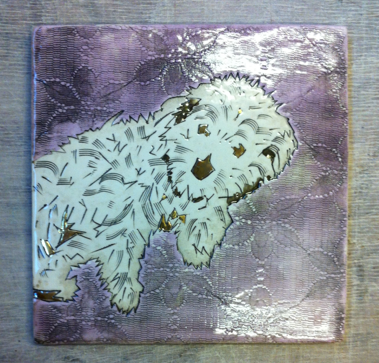 This is Bun Bun, psycho terrier contary to fluffy first impressions. His owner Mr Scruff wanted a tile to commemorate Bun Bun's entry into the guinness book of records for fluffies dog on the planet. He emailed me a photo of Bun Bun and this is I tile I made.