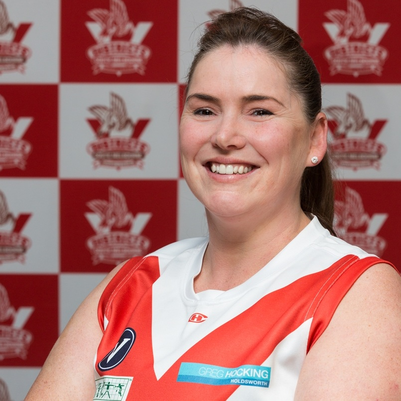Kate K  Jumper #55 is being worn confidently and proudly by Kate K this year. She joined the bloods at the beginning of the 2018 season. Kate brings another crucial profession to the Bloods team- she is a 'Wound care consultant', hopefully we won't have to use her skills! Anna gets a big shout out for recruiting Kate and giving her another thing to be proud of! Away from the field and the hospital you'll find Kate flying down the slopes on her Snowboard- probably fueled by her love of coffee!