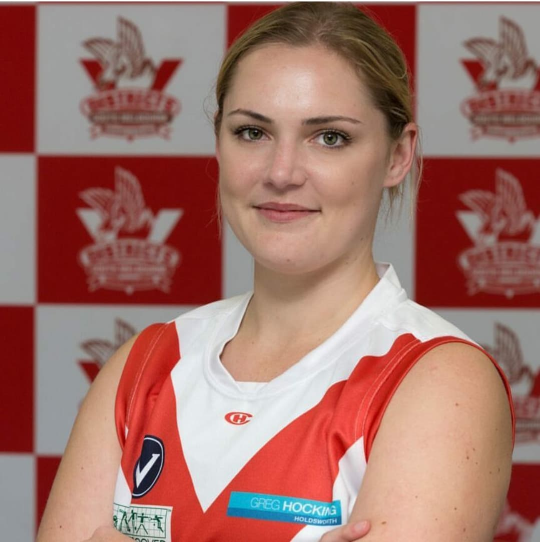 """Nikki  Joining us in 2018 is our #66 is all the way from Queensland- Nikki. She thought she'd check out the AFLW hype when she touched down in Melbourne. Nikki, our very own 'wanna-be' mermaid came to SMDFC through the skills academy and has discovered her place on the oval at half-forward. When asked her biggest sporting achievement Nikki didn't hesitate in saying """"winning our first practice match as the Bloods""""- I have no doubt she'd add the 2019 season to that achievement file now!"""