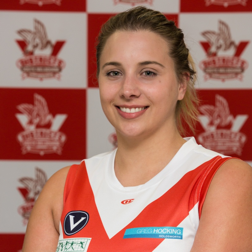 Jane  This year our #4 player, and the reserves team captain, is Jane. She came to play football back in 2017 and joined the Bloods through the SMDFC skills academy. Jane has become a regular feature in our forward line. Jane has 2 big sporting achievements in her life- one is 1st place in C grade touch rugby and the other is for 1st place in a nacho eating competition- she couldn't pick the best! Away from sport Jane is the proud mother of 19 houseplants who she takes great pride in and her dream is to be able to learn pottery to make all of them new pots to live in!