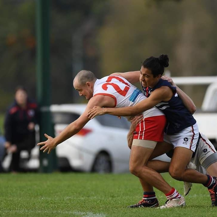 Luke  Bags is an integral member of SMDFC both on and off the ground. He jumper number and playign years are nearly the same- he's been running out as our ruck/ half forward in the #14 for 13 years (pictures in a replacement after an unfortunate instance of the jumper being torn in 2018), 2020 will be a good year for Bags on that basis. This 'angry bald man' can be found having some casual Friday beers during the season or on one of may other sporting grounds/courts. Luke is adept at basketball, golf and cricket- all washed down with a healthy beer or 2.