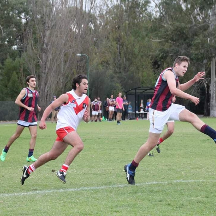 Akin  Din also a part of our 2019 U19 Squad. He's made an impression at SMDFC and proudly wears the #15 jumper while playing ruck rover. Akin came to footy to play alongside his mates and we are so pleased especially after he kicked a goal from outside the boundary to put us ahead with 2 minutes to play!! Off the field you'll find Din catching up on Game Of Thrones on his couch or watching the footy on a Friday night