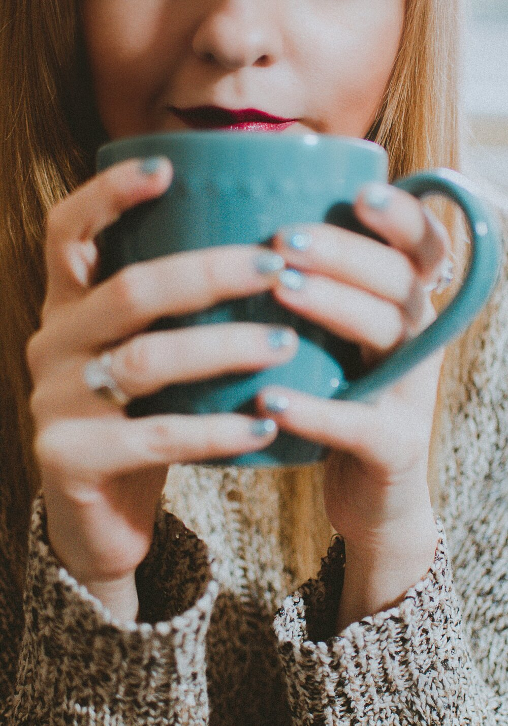 uwm.tcm.gold.tinctures.woman-holding-blue-ceramic-mug-1834083.jpg