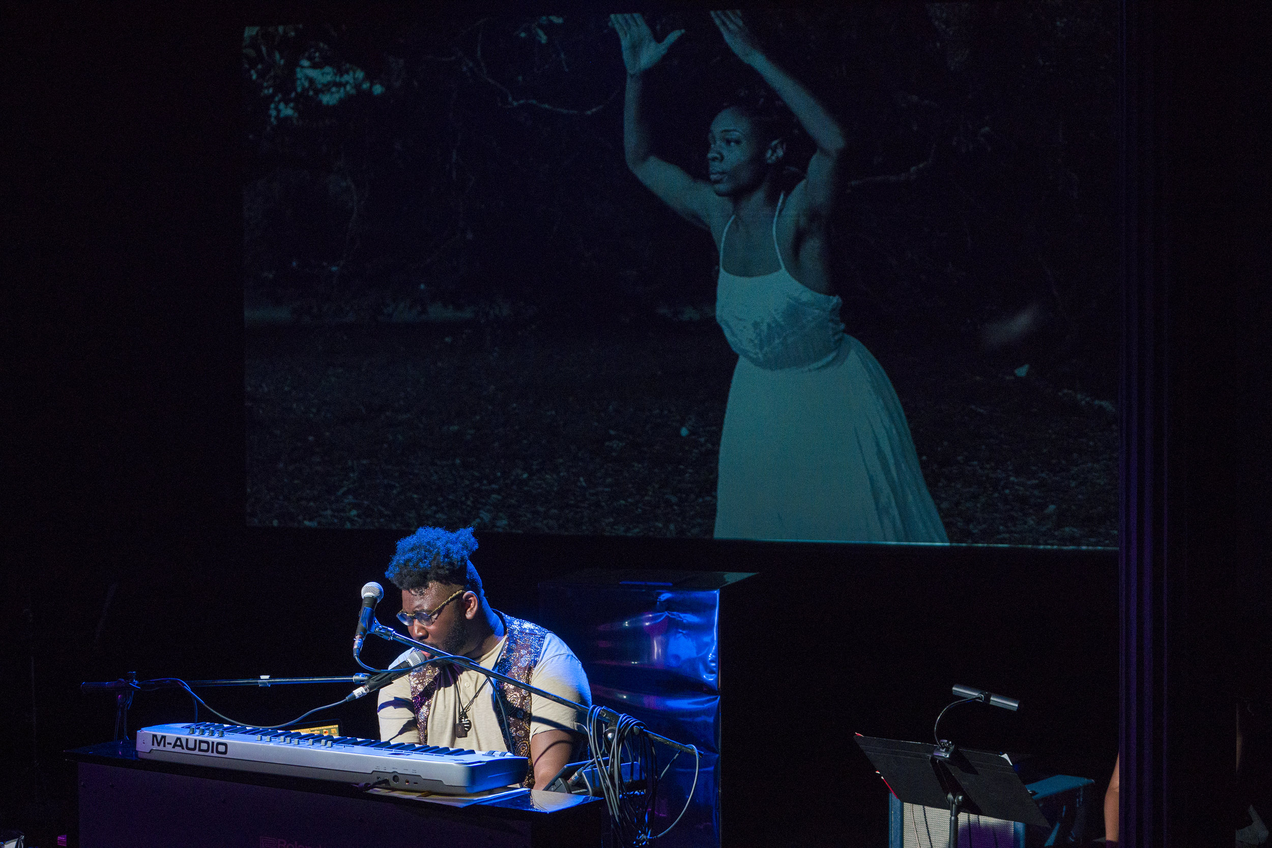 Tariq Al-Sabir performing original song cycle Unwanted  Visuals: Monique Muse Dodd  Dancer: Chanté Michele  Photo Credit: Richard Termine (c) Mabou Mines