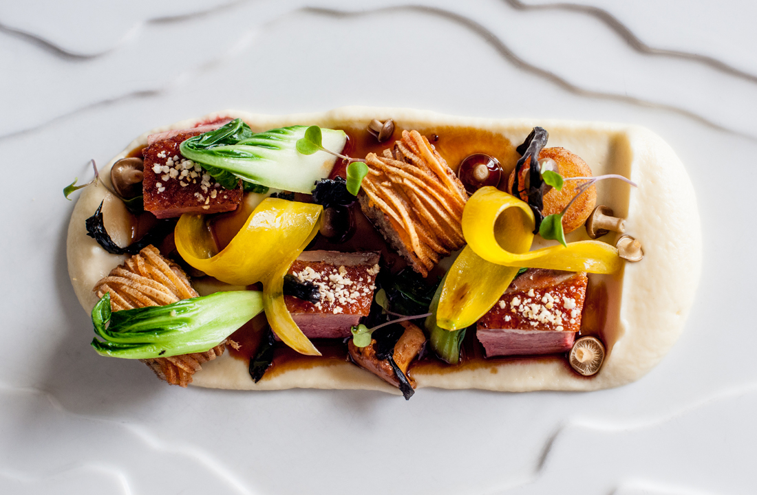 Roasted Irish Duck breast with assiette of steamed vegetables