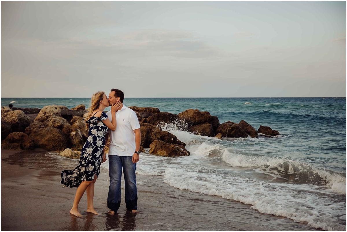 couple kissing on beach