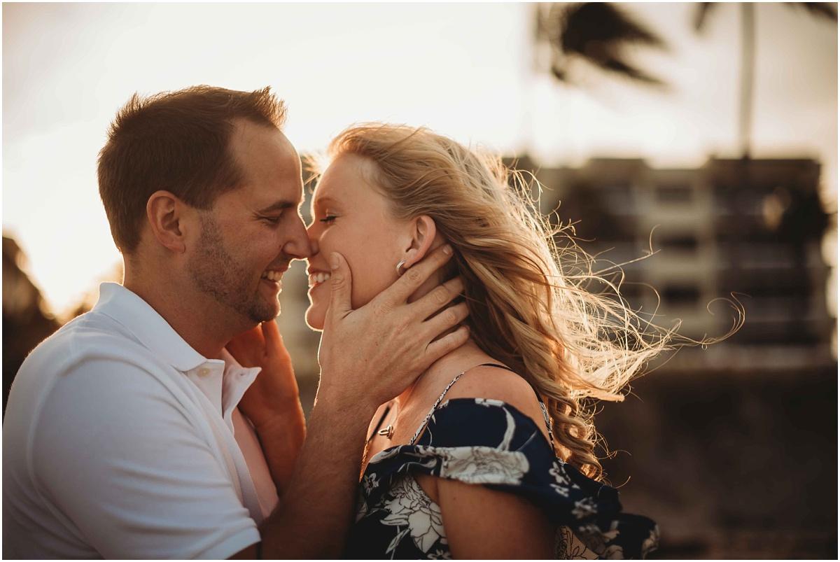 couple kissing in sunlight