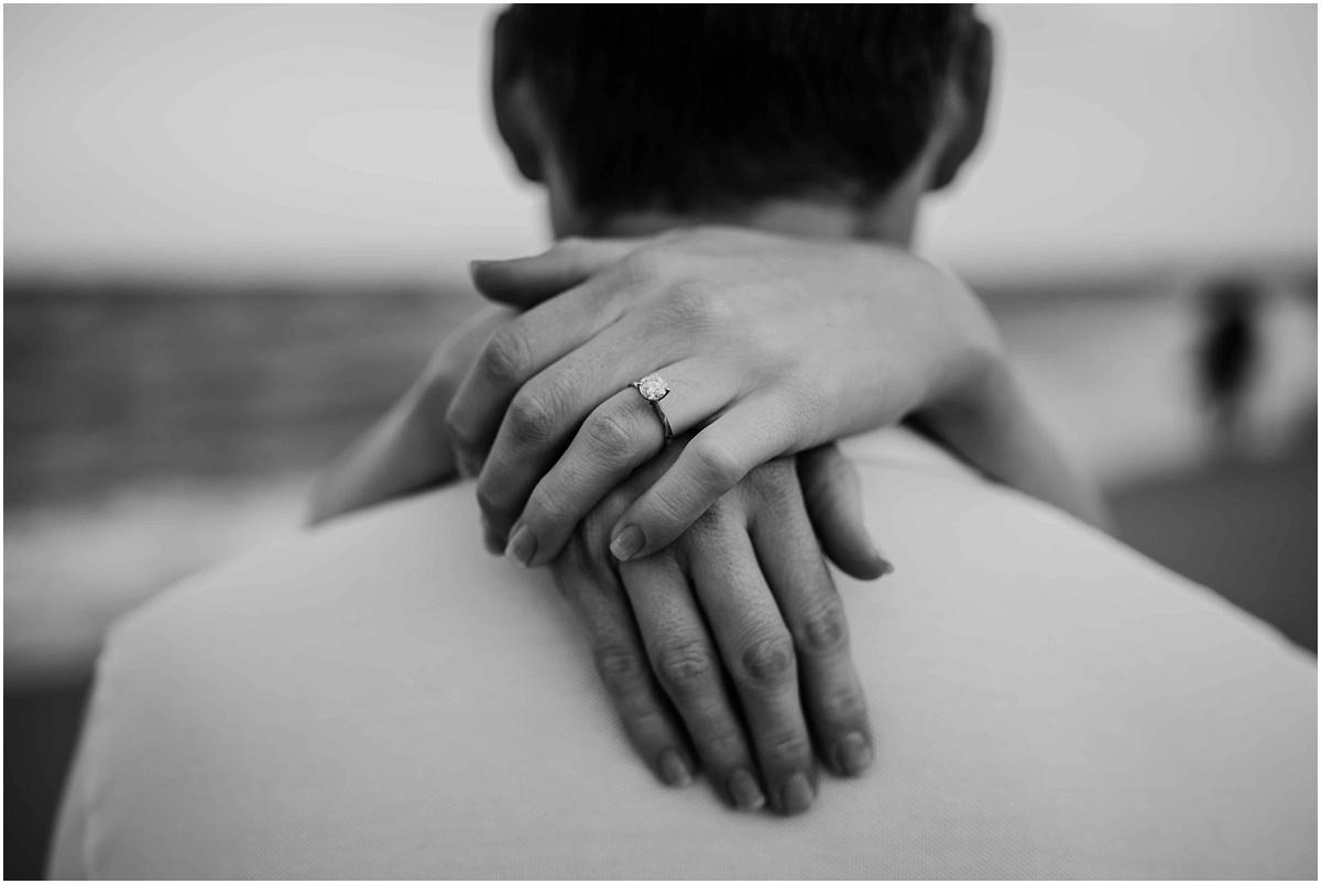 engagement ring woman hugging man