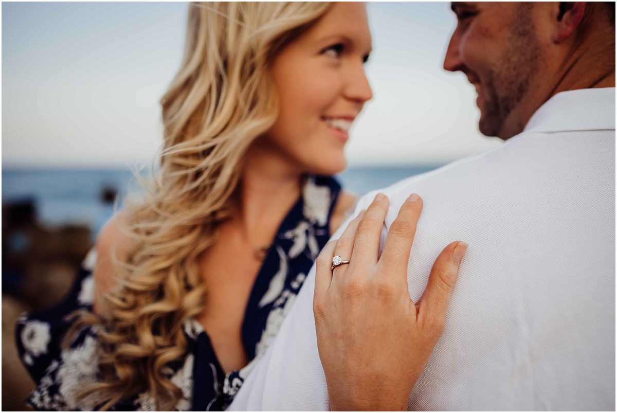 girl holding man and engagement ring