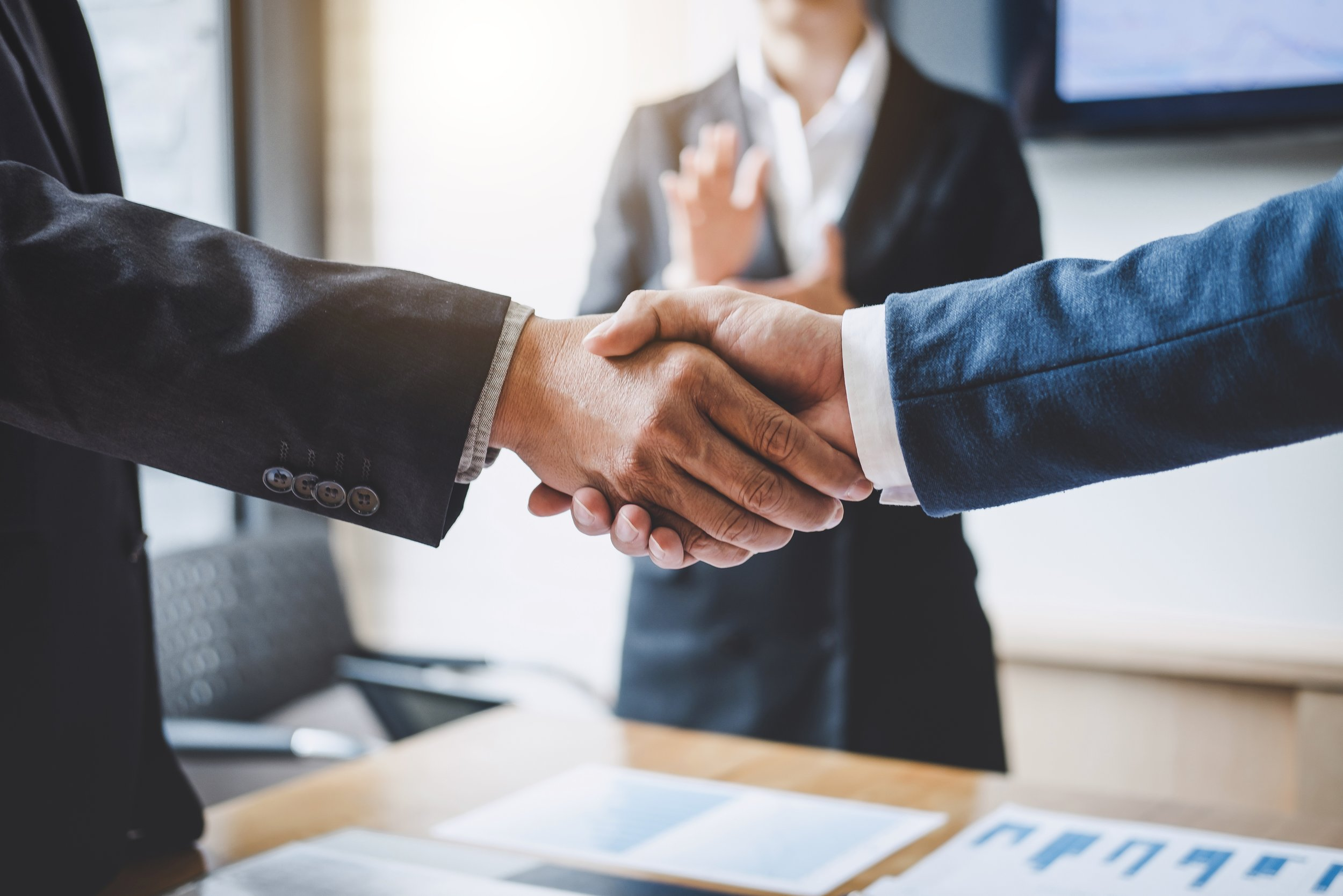 finishing-up-a-meeting-business-shaking-hands-after-discussing-good-deal-of-trading-to-sign-agreement.jpg