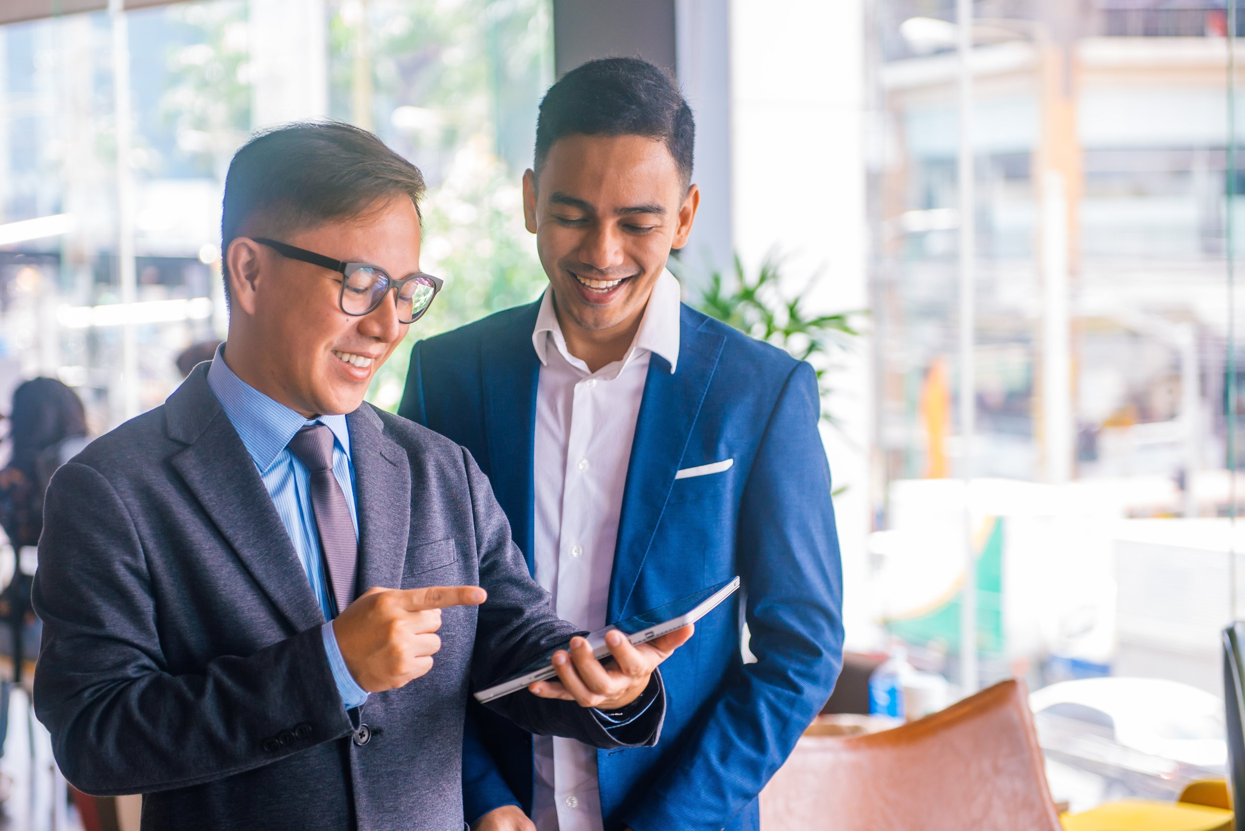 men-meeting-to-discuss-on-tablet.jpg