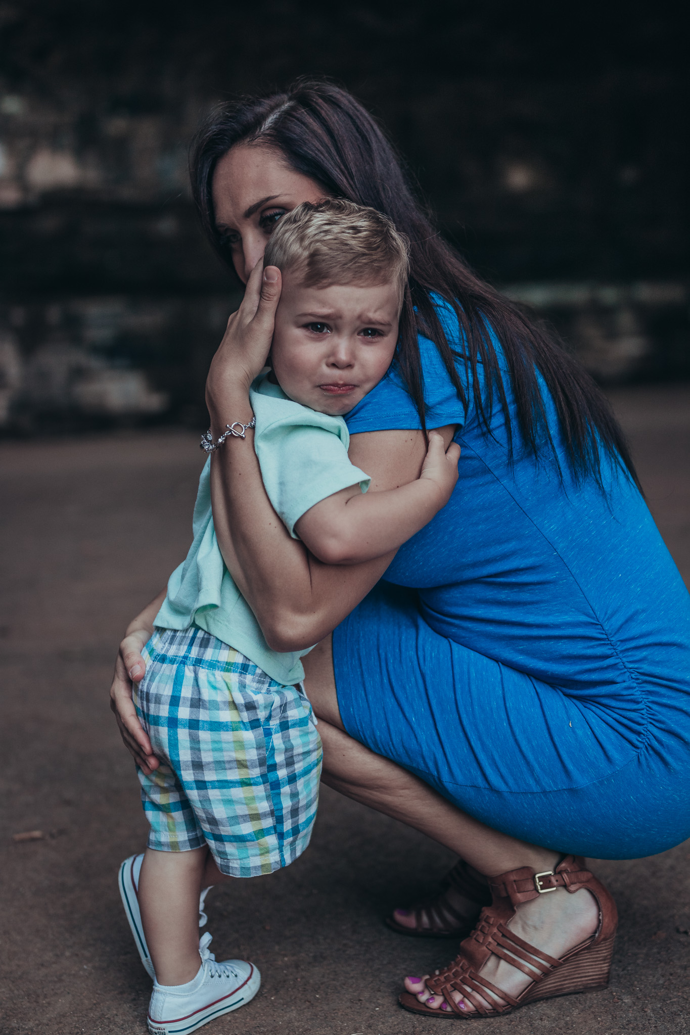 mom comforting sad toddler