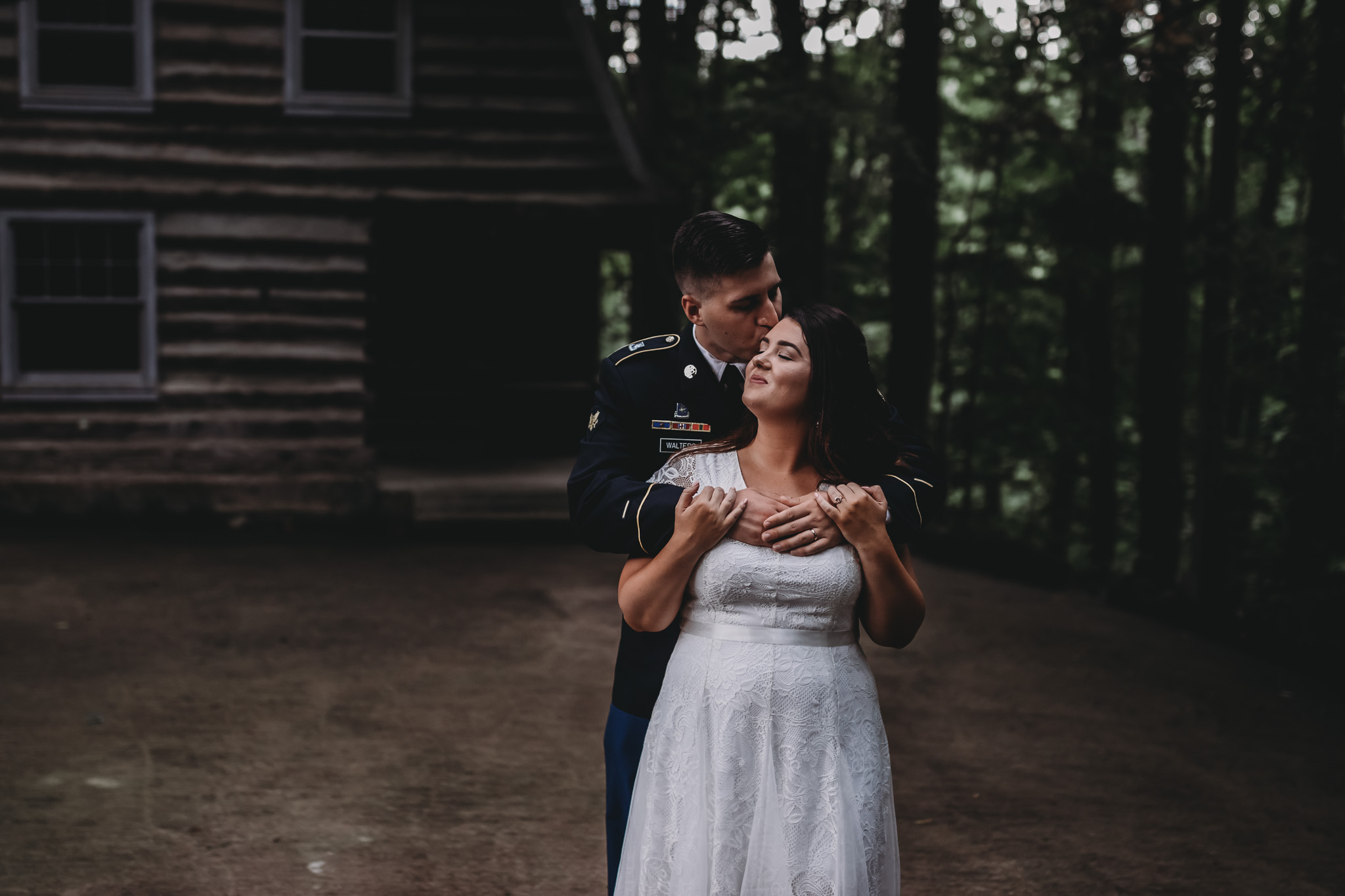 groom wrapping bride in hug