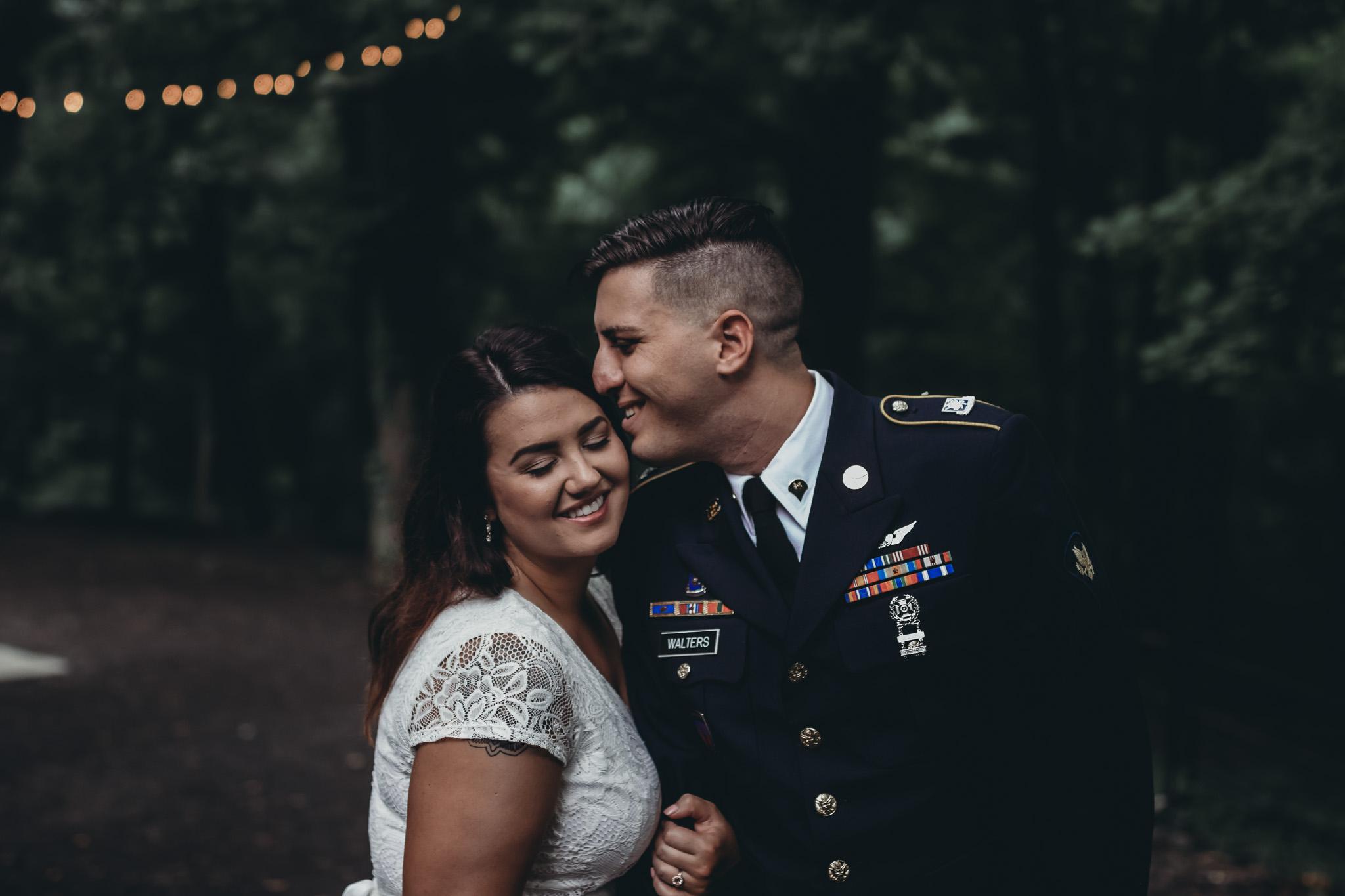 army military groom loving on his bride