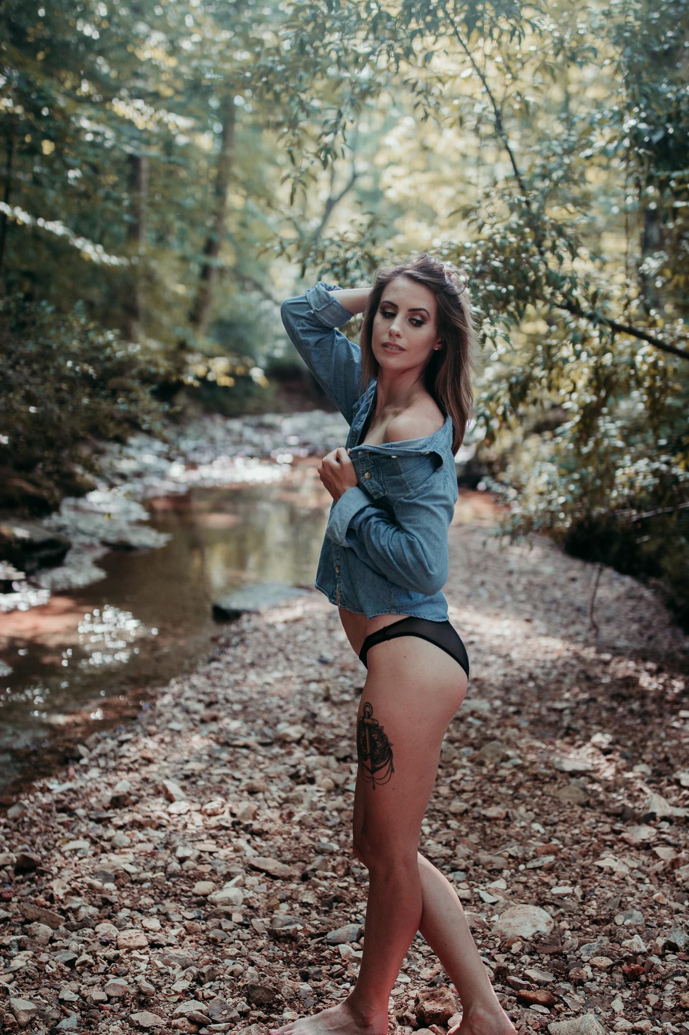 standing in jean shirty boudoir pose