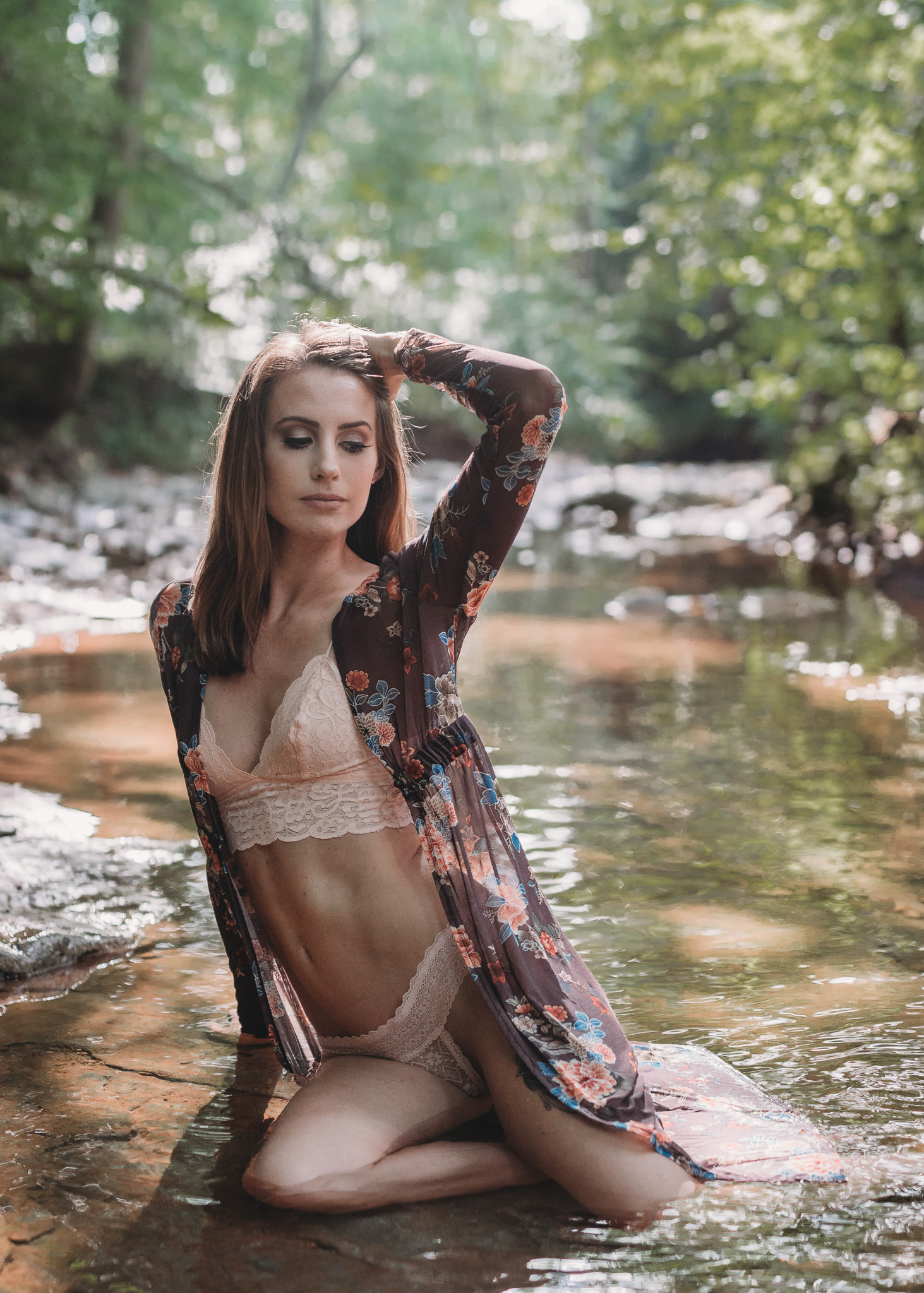 sitting in water boudoir pose