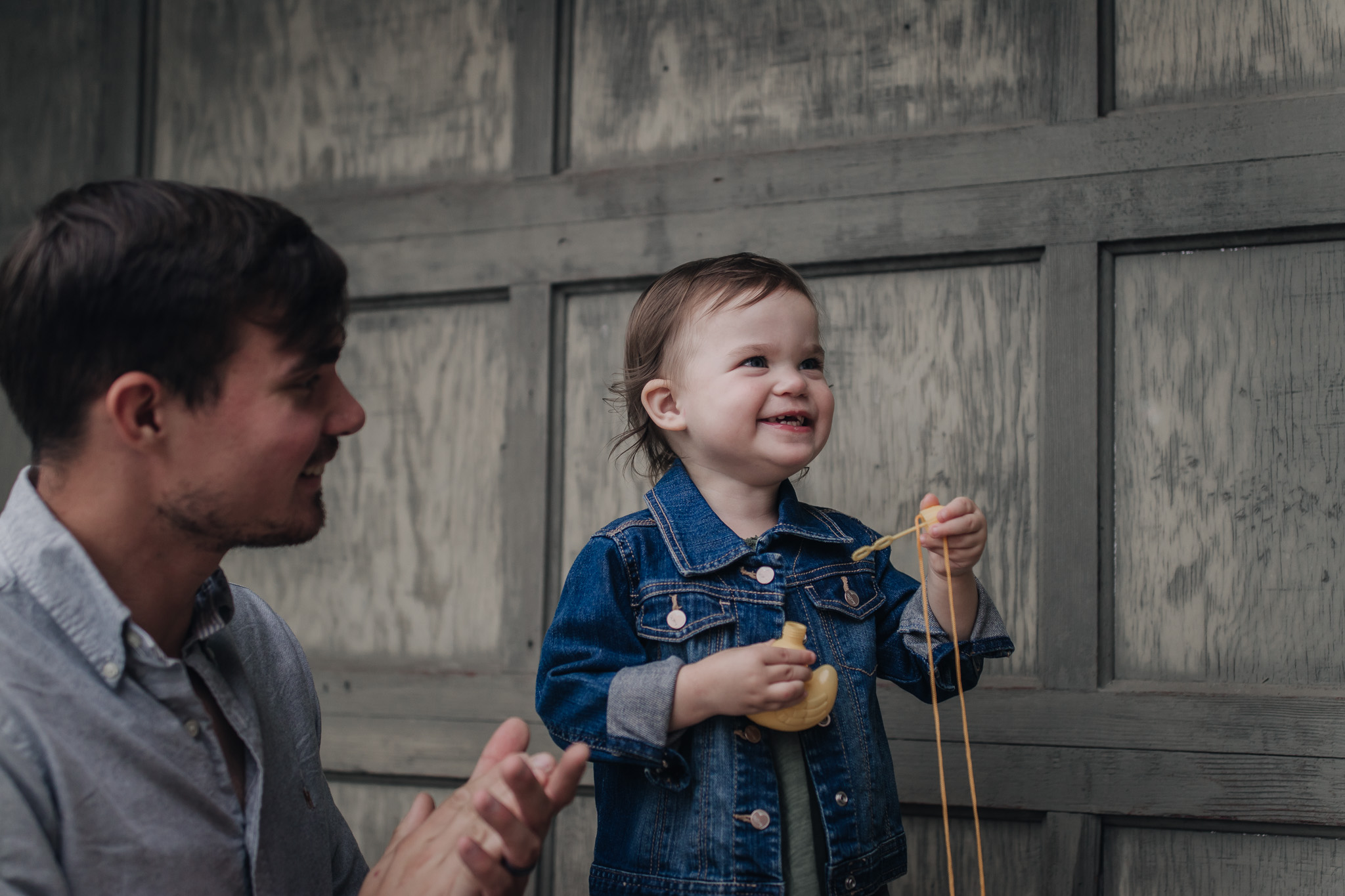 child blowing bubbles with dad