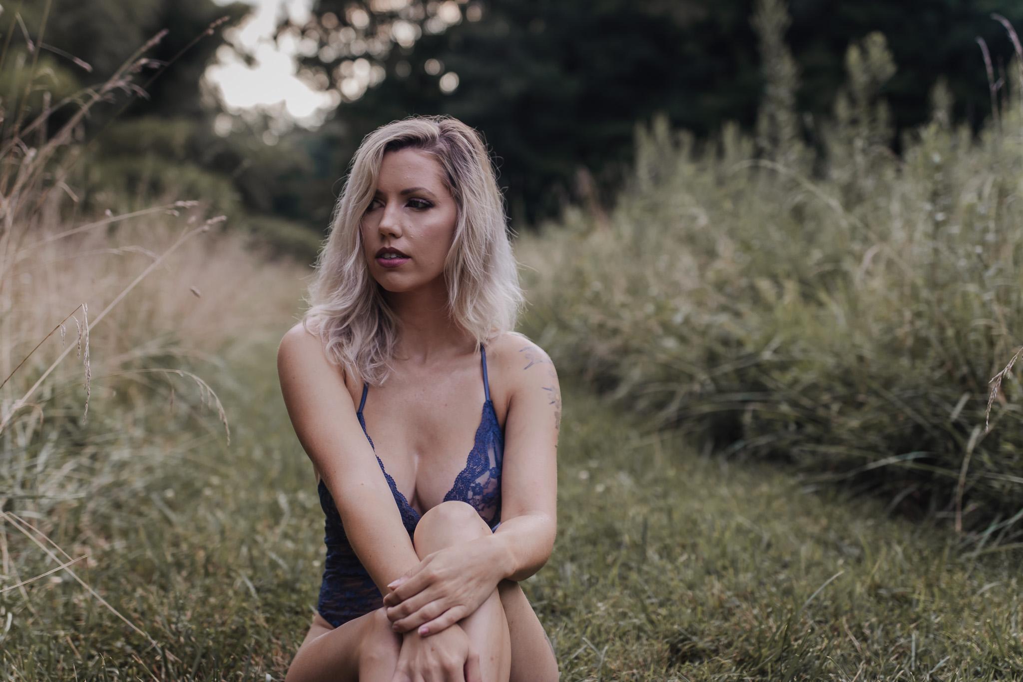 outdoor boudoir girl sitting in field