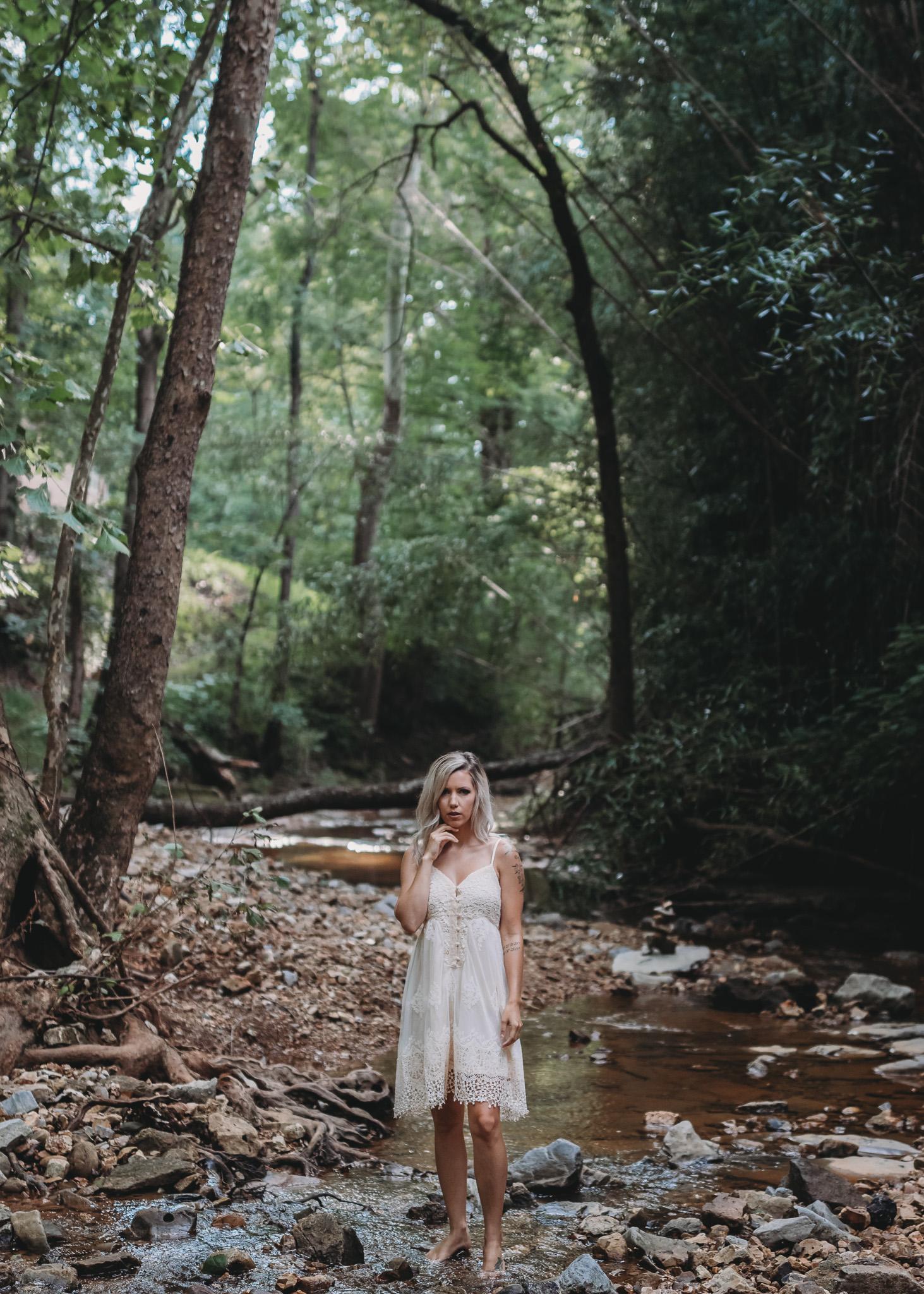 outdoor boudoir in a creek standing pose