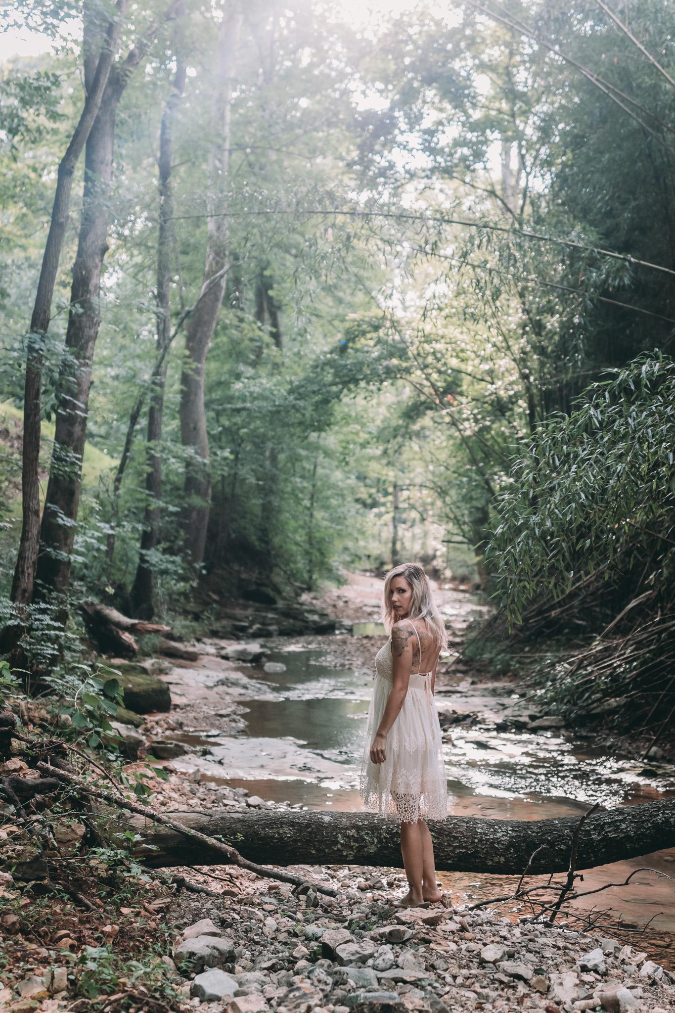 girl standing in creek outdoor boudoir