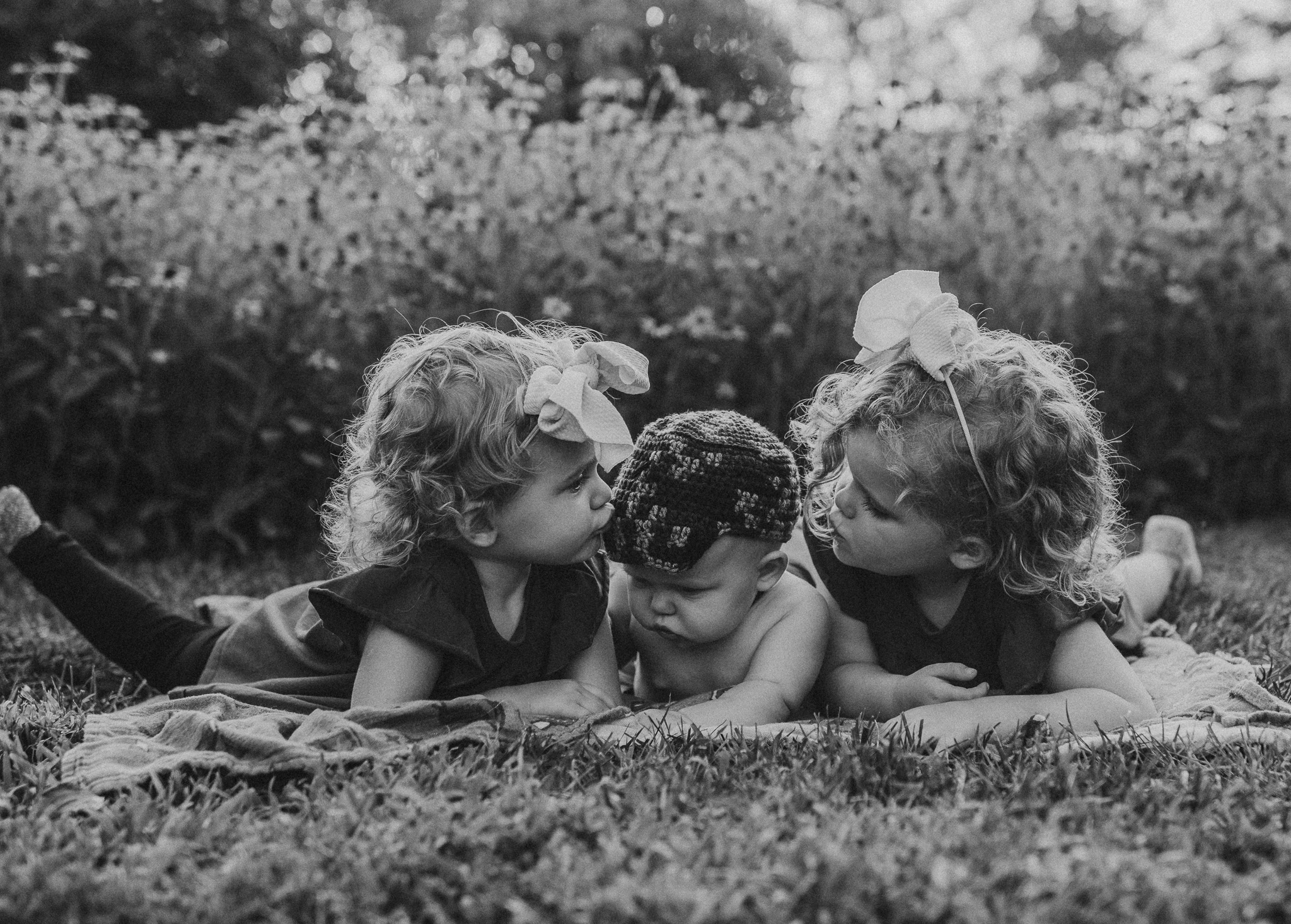 black and white photo of kids kissing