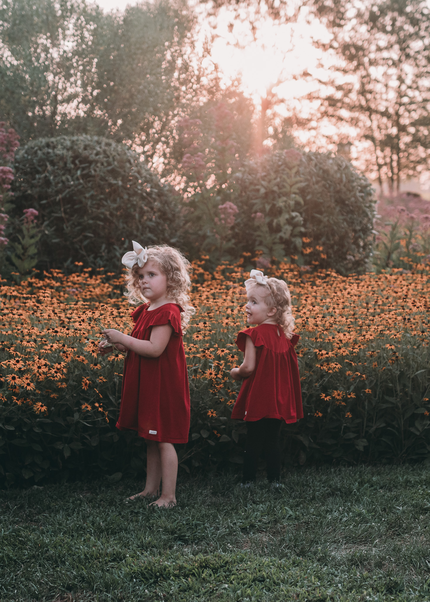 girls in sunset with flowers