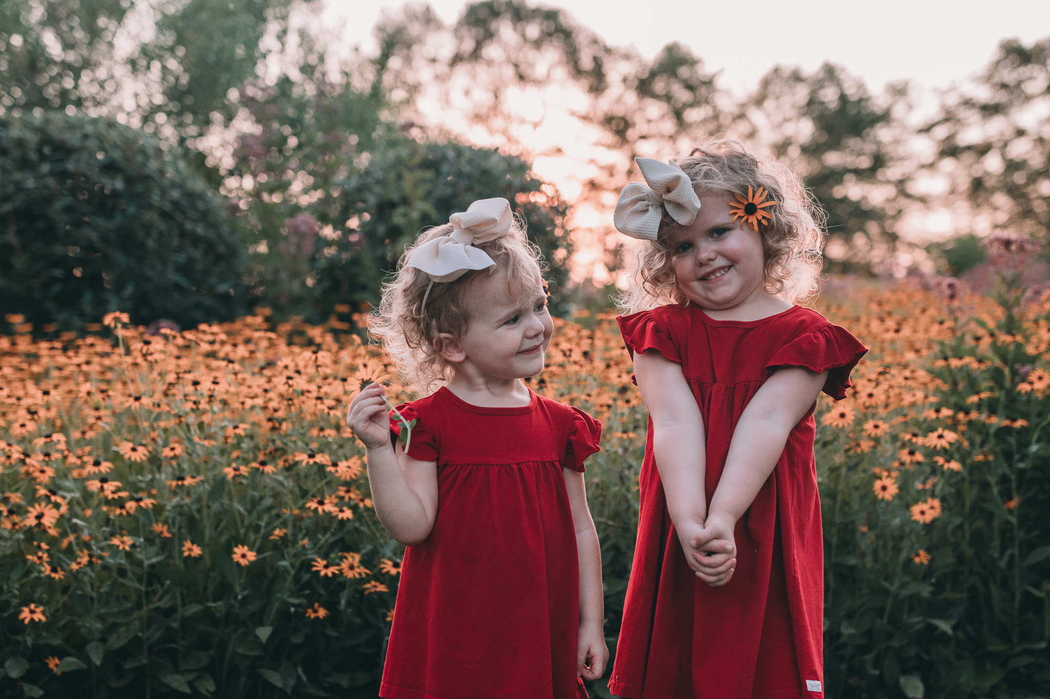 girls with flowers in sunset