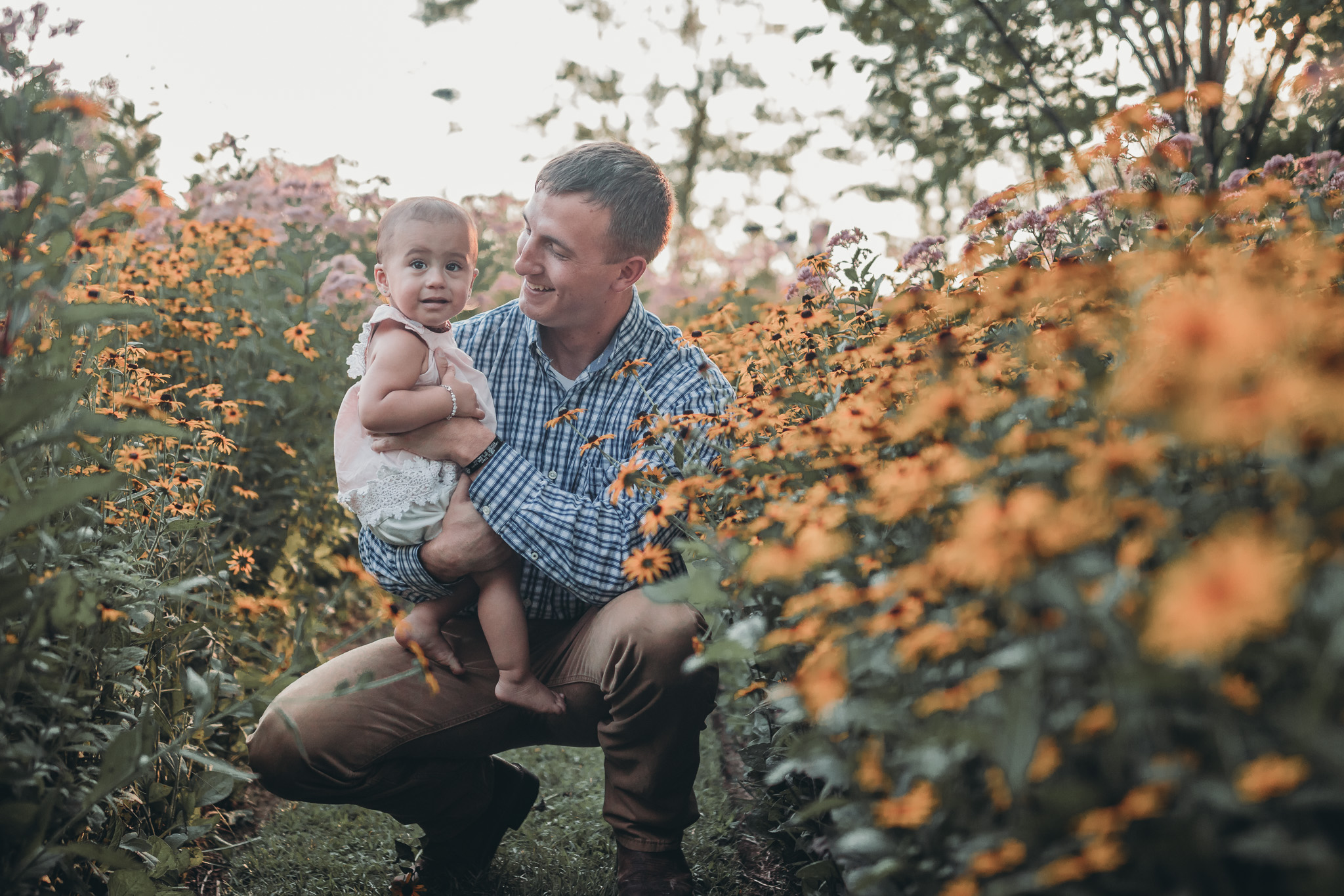 dad and baby in flowers