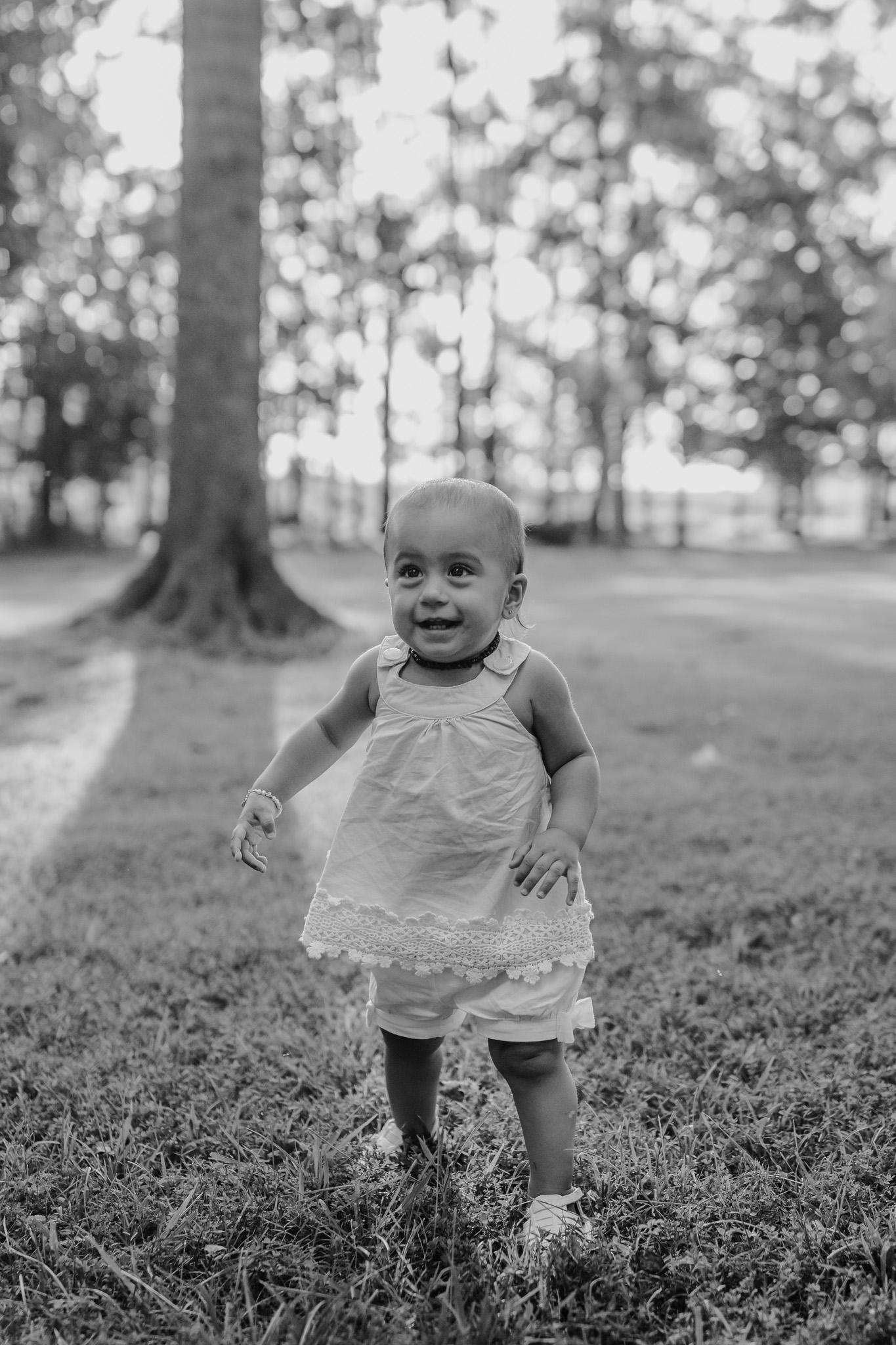 baby walking black and white photo
