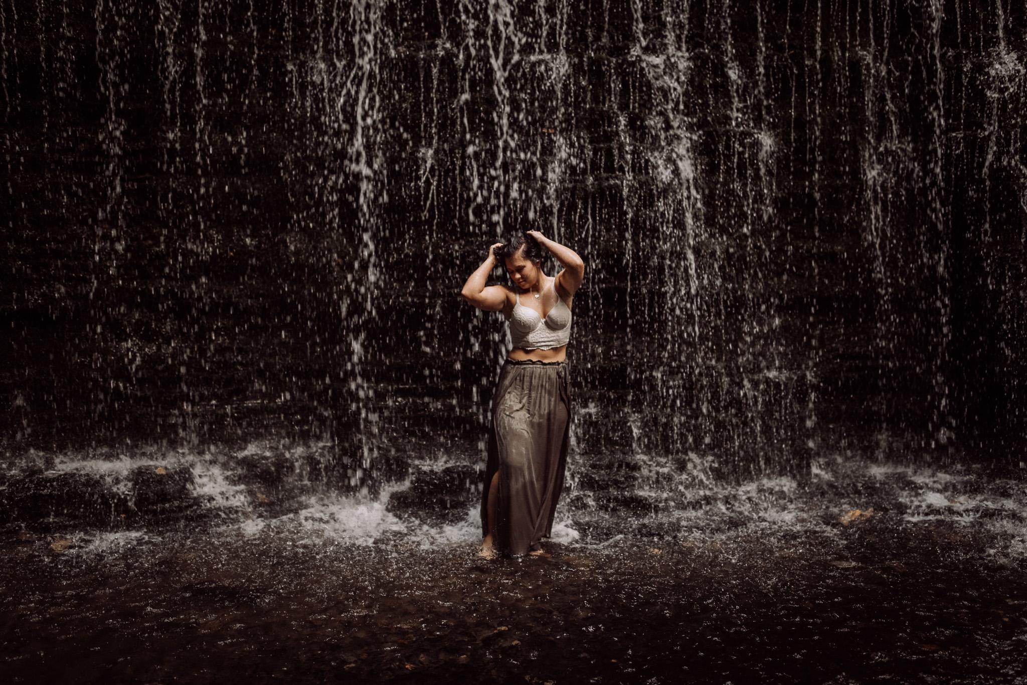 standing in waterfall boudoir pose