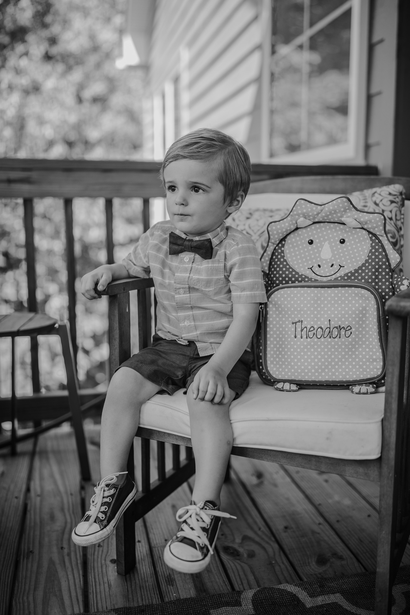 little boy sitting with backpack