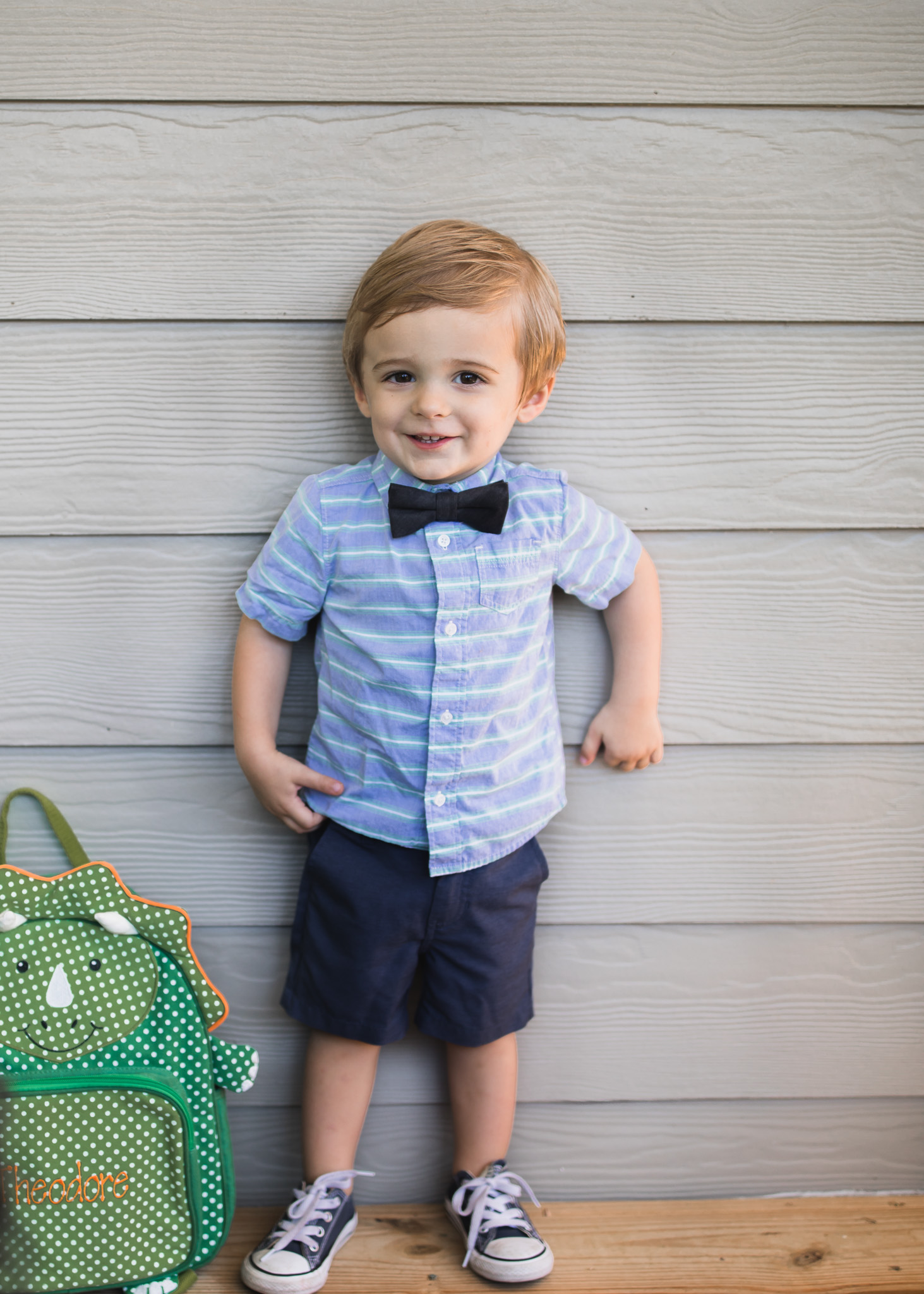 toddler standing for photos