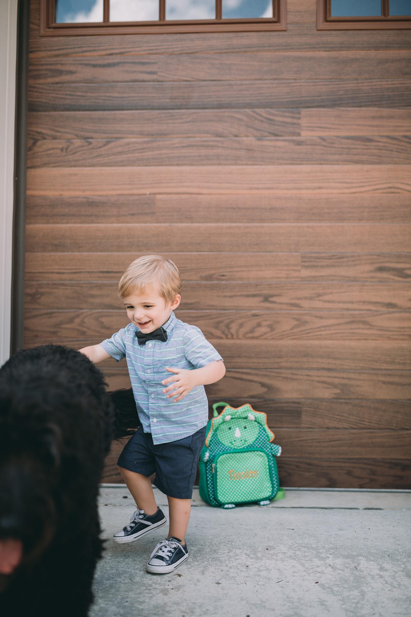 boy chasing dog