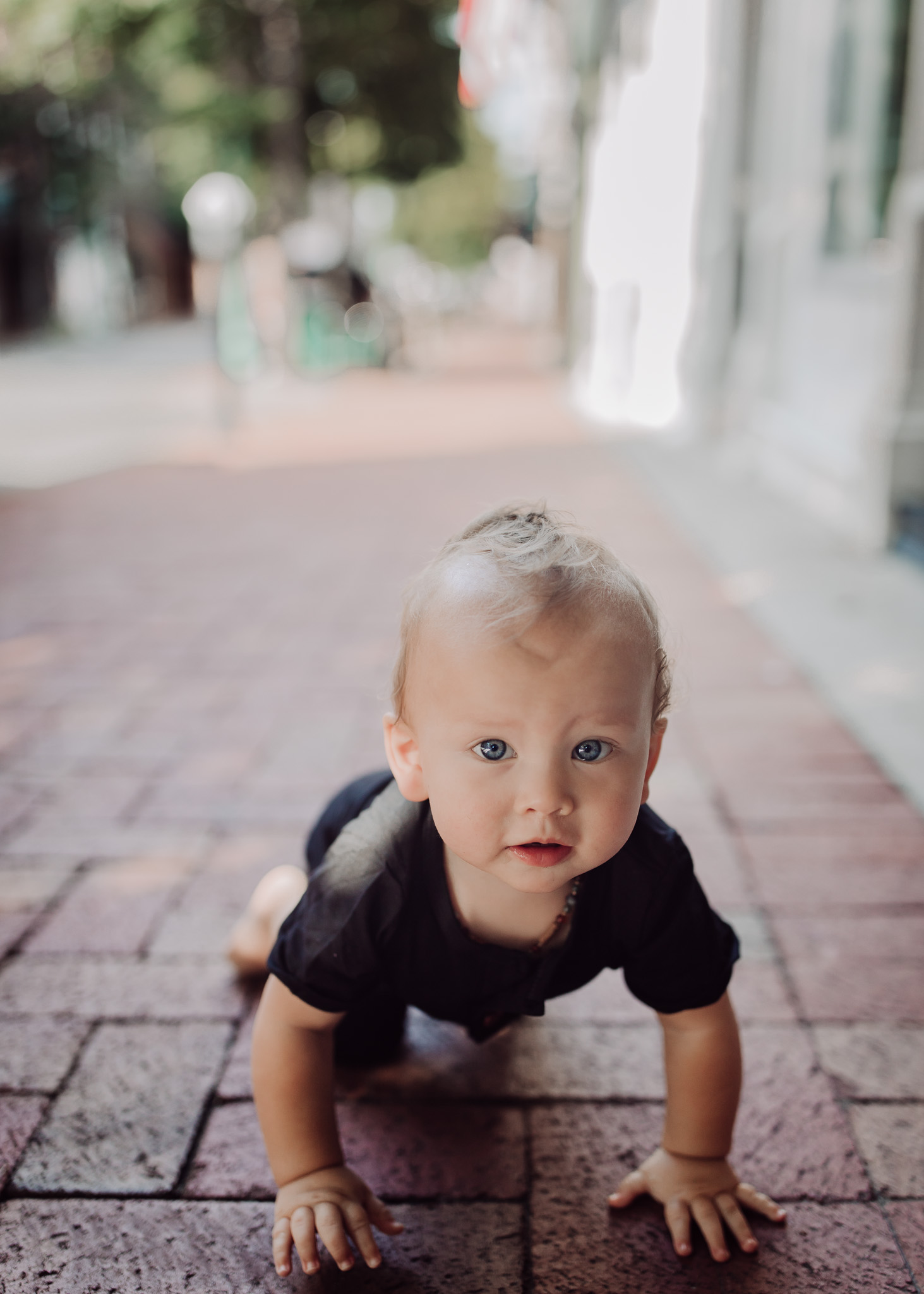 baby crawling downtown