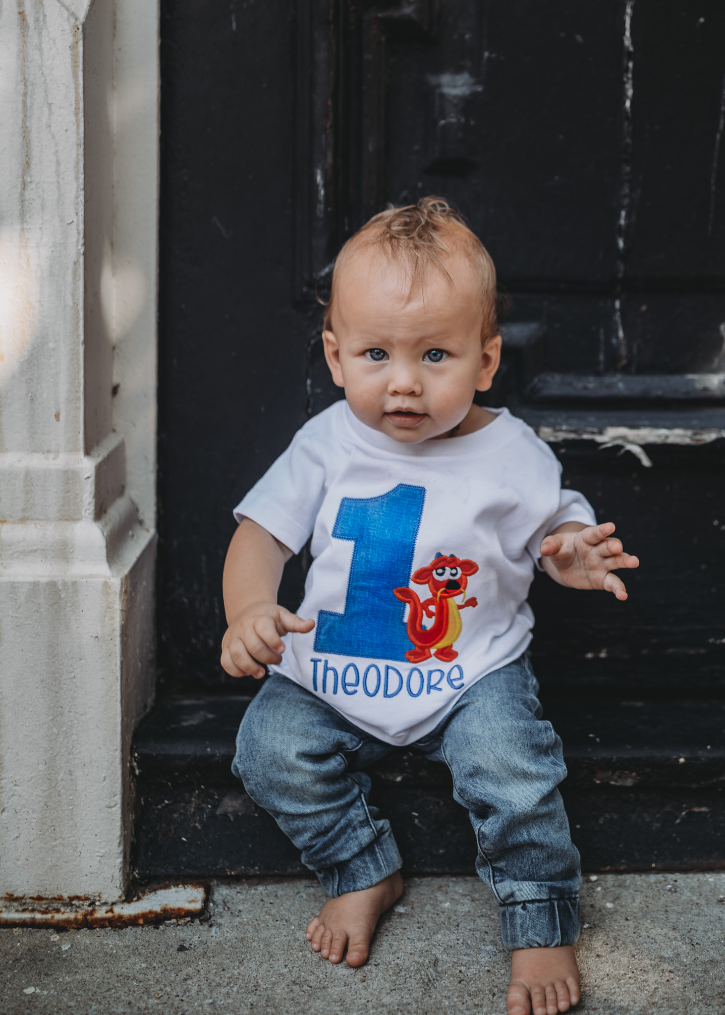 baby in one year old shirt