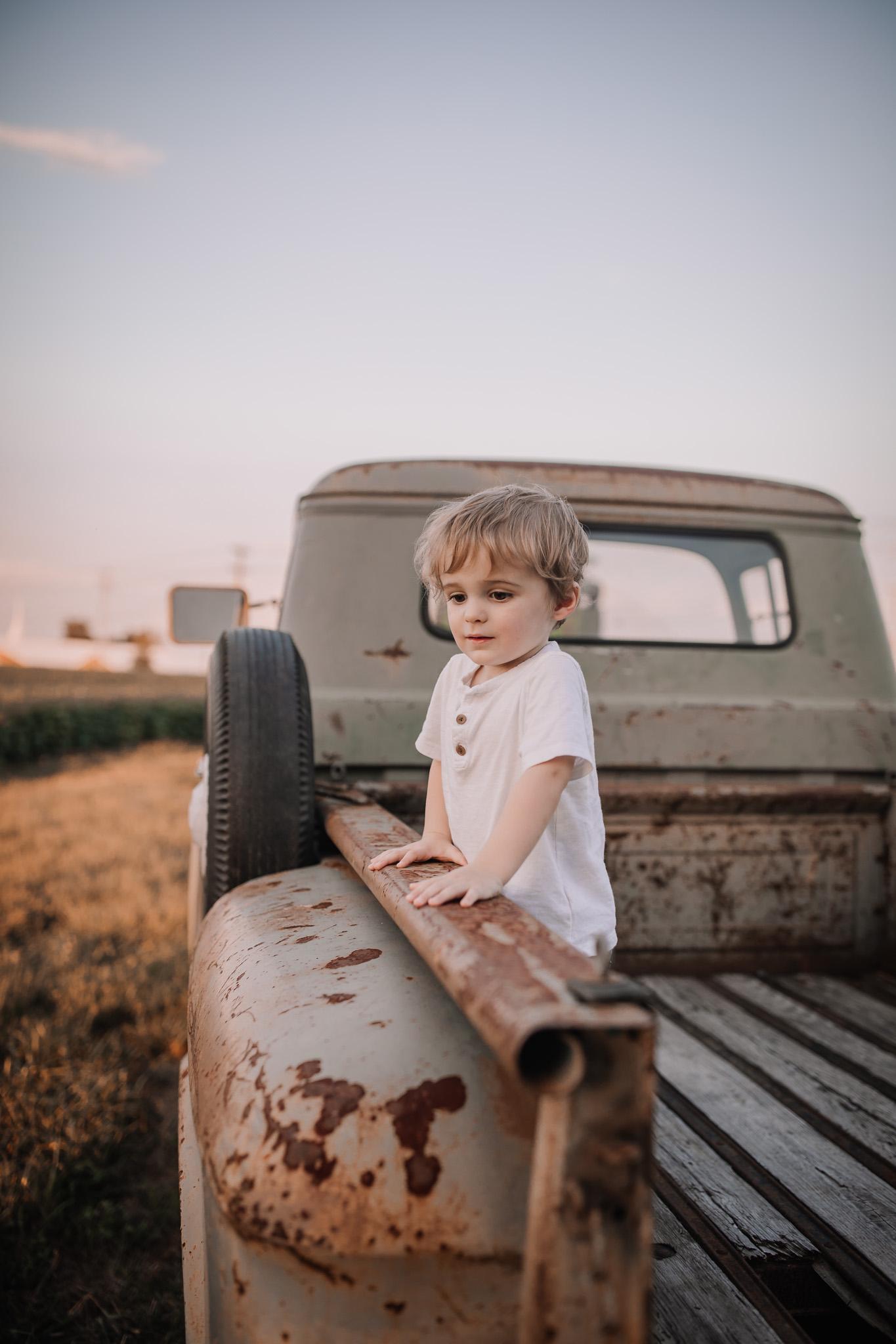 toddler in vintage truck pick up bed