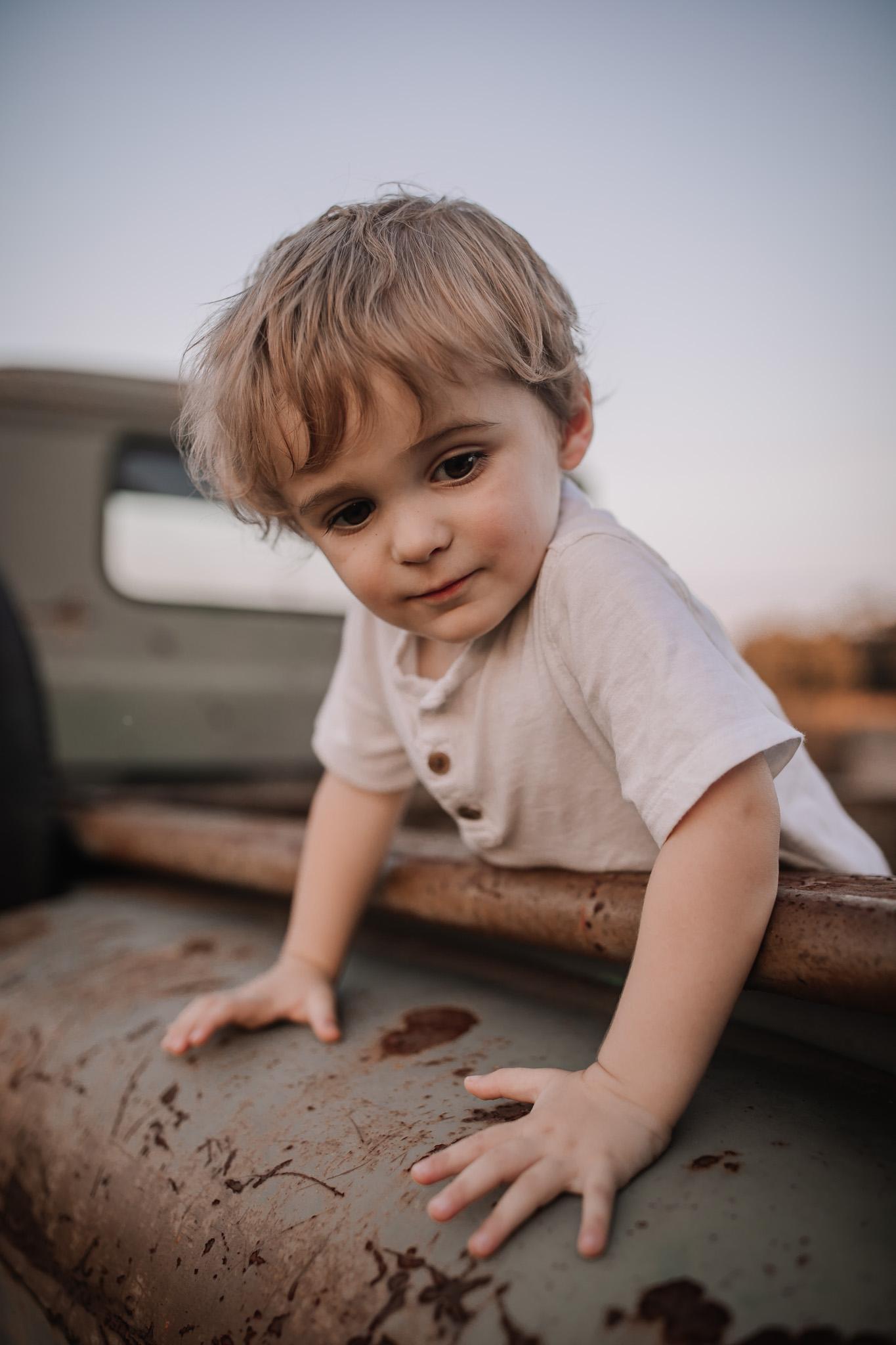 toddler in vintage truck bed