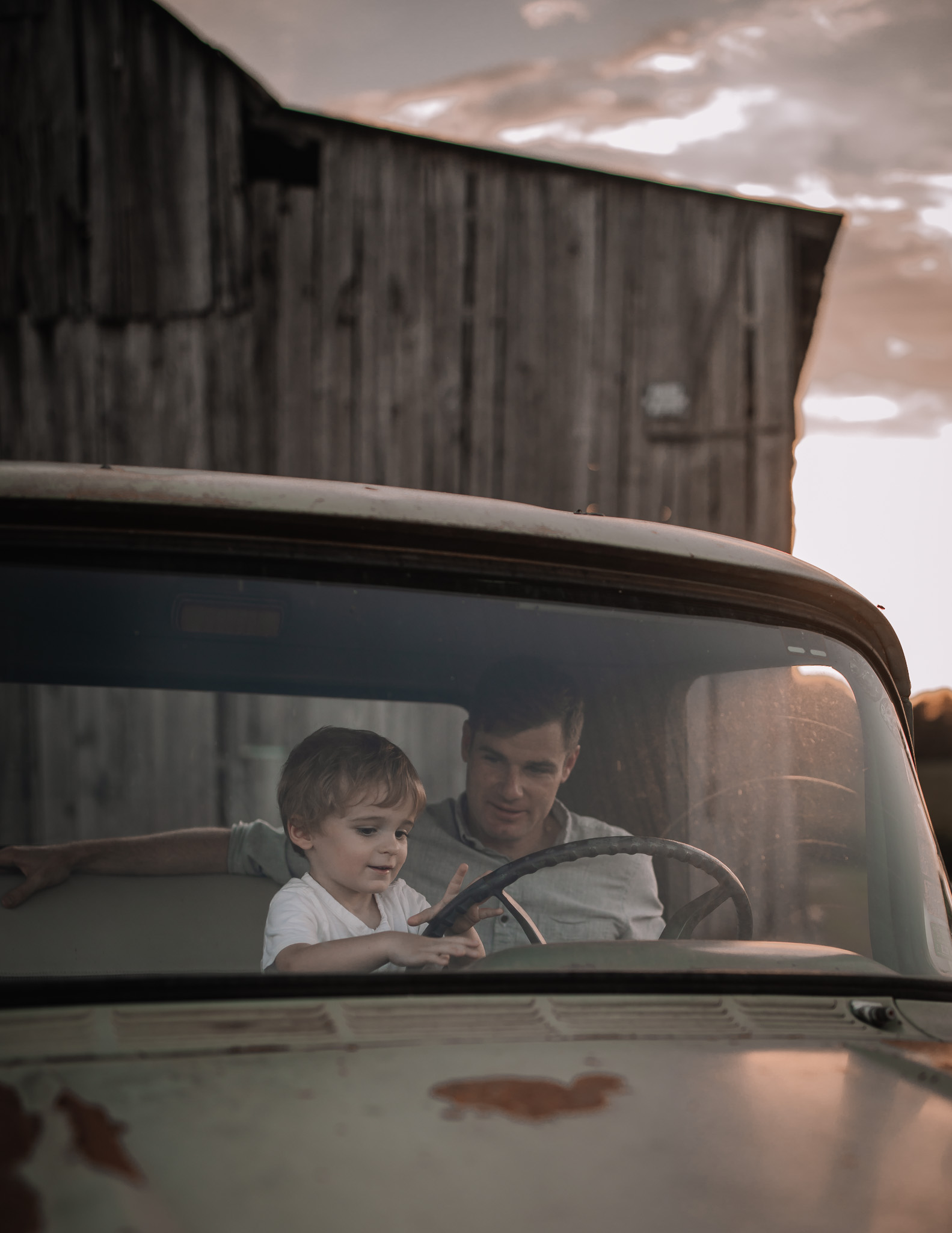 toddler and father in vintage truck