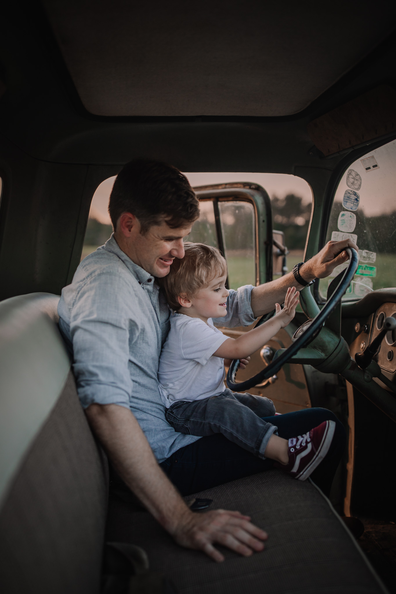 father and son in vintage truck driving